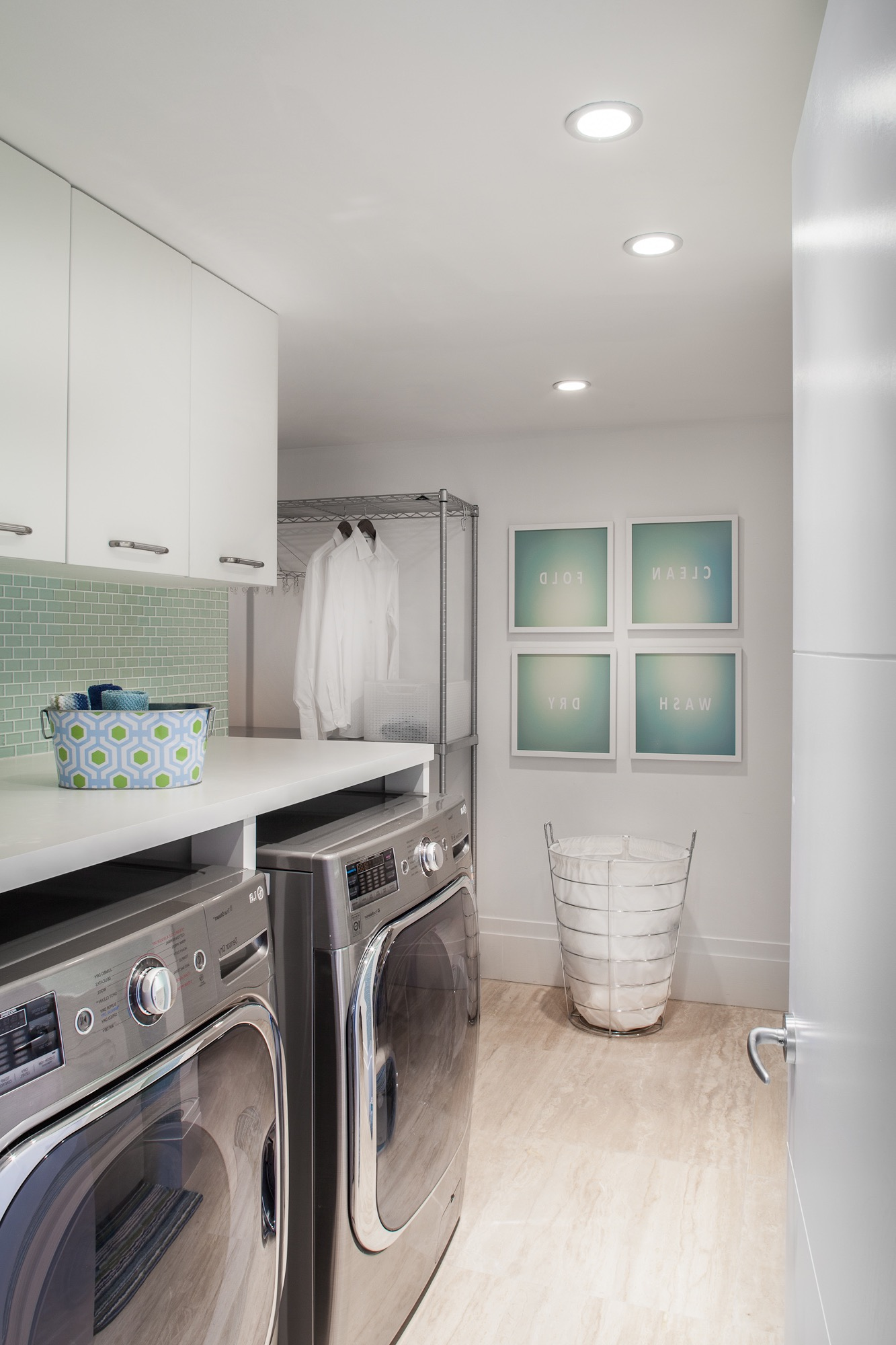 Cozy White Laundry Room With Tile Backsplash (Image 8 of 26)