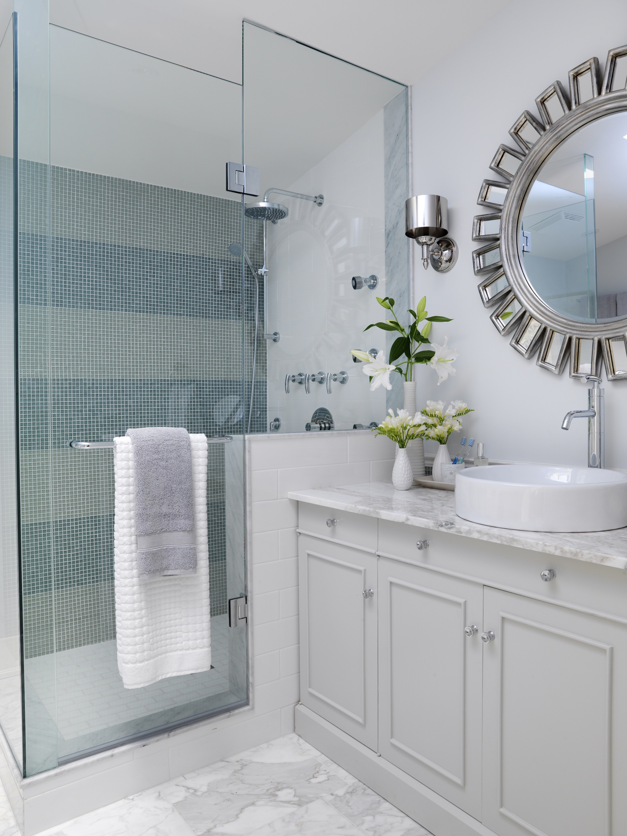 Elegant Small Bathroom With Dark Wood Cabinetry And Stark White Countertops (Image 6 of 14)