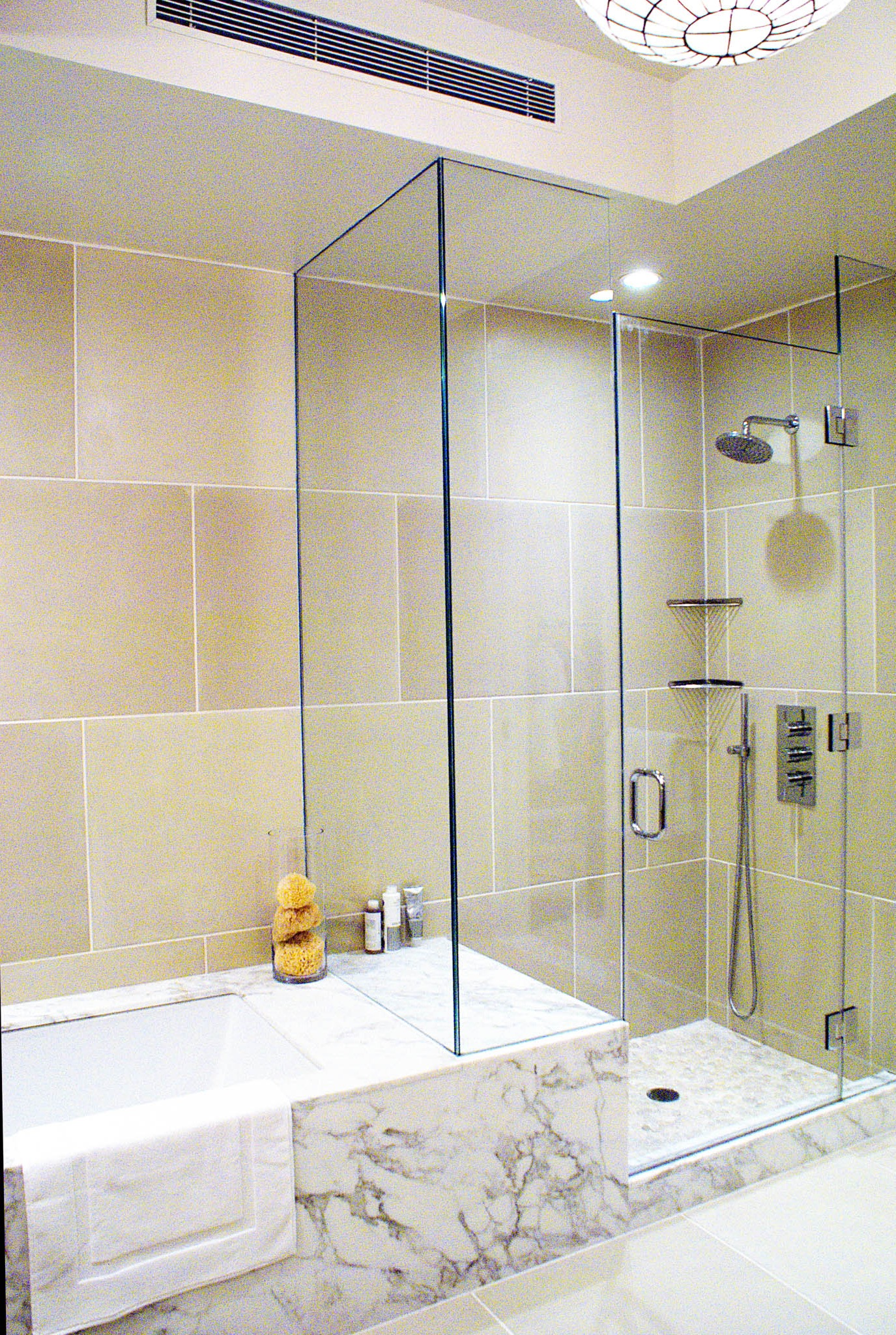 Limestone Tile Bathroom With Pebble Floor Shower And Bathtub Combination (Image 10 of 19)