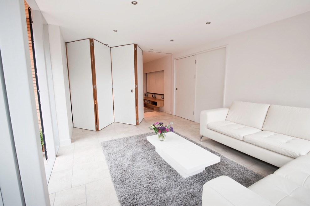 Trendy Modern Apartment Living Room With White Bifold Doors Divider (Image 21 of 24)