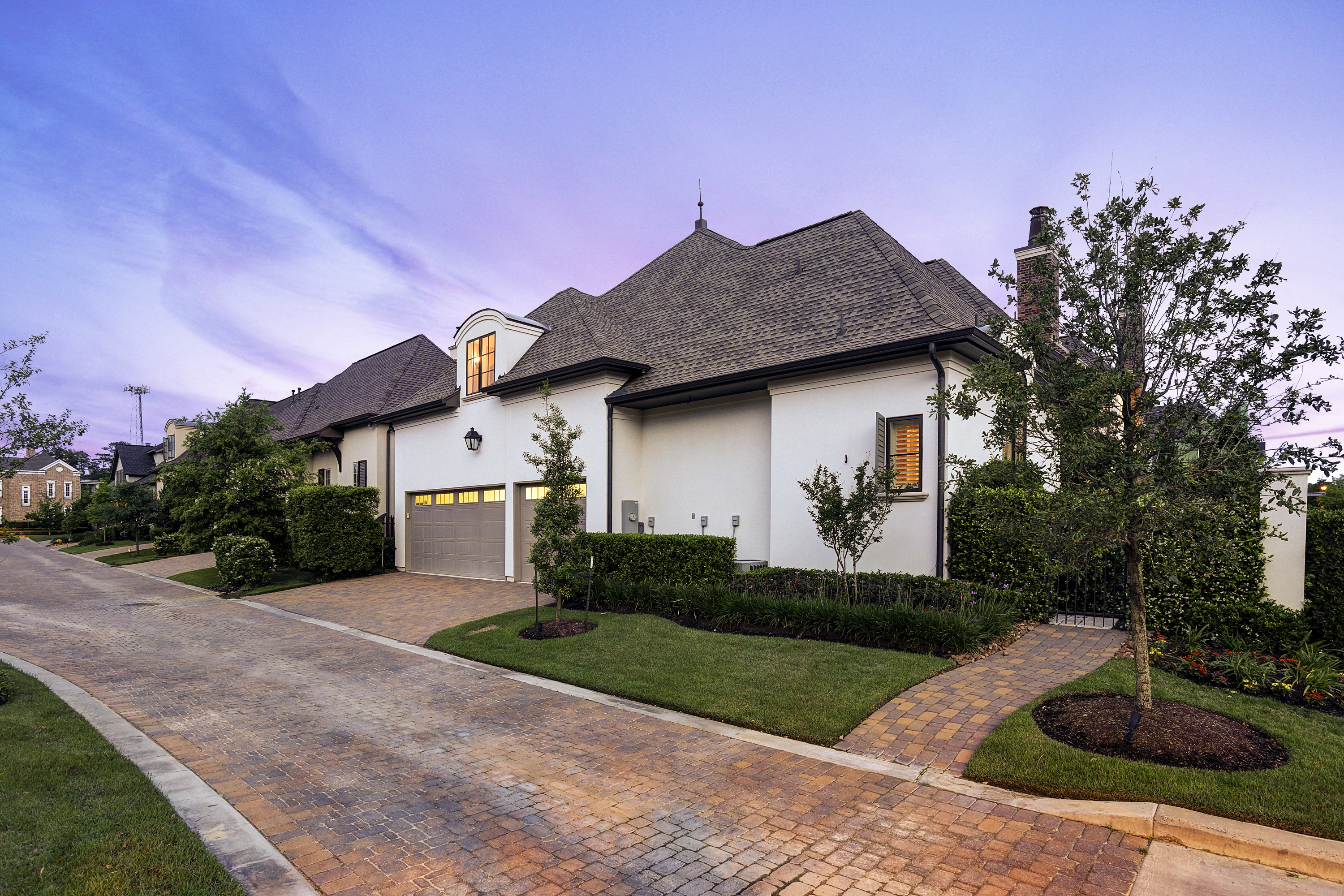 Brick Driveway And Neutral Garage Doors (Image 1 of 38)