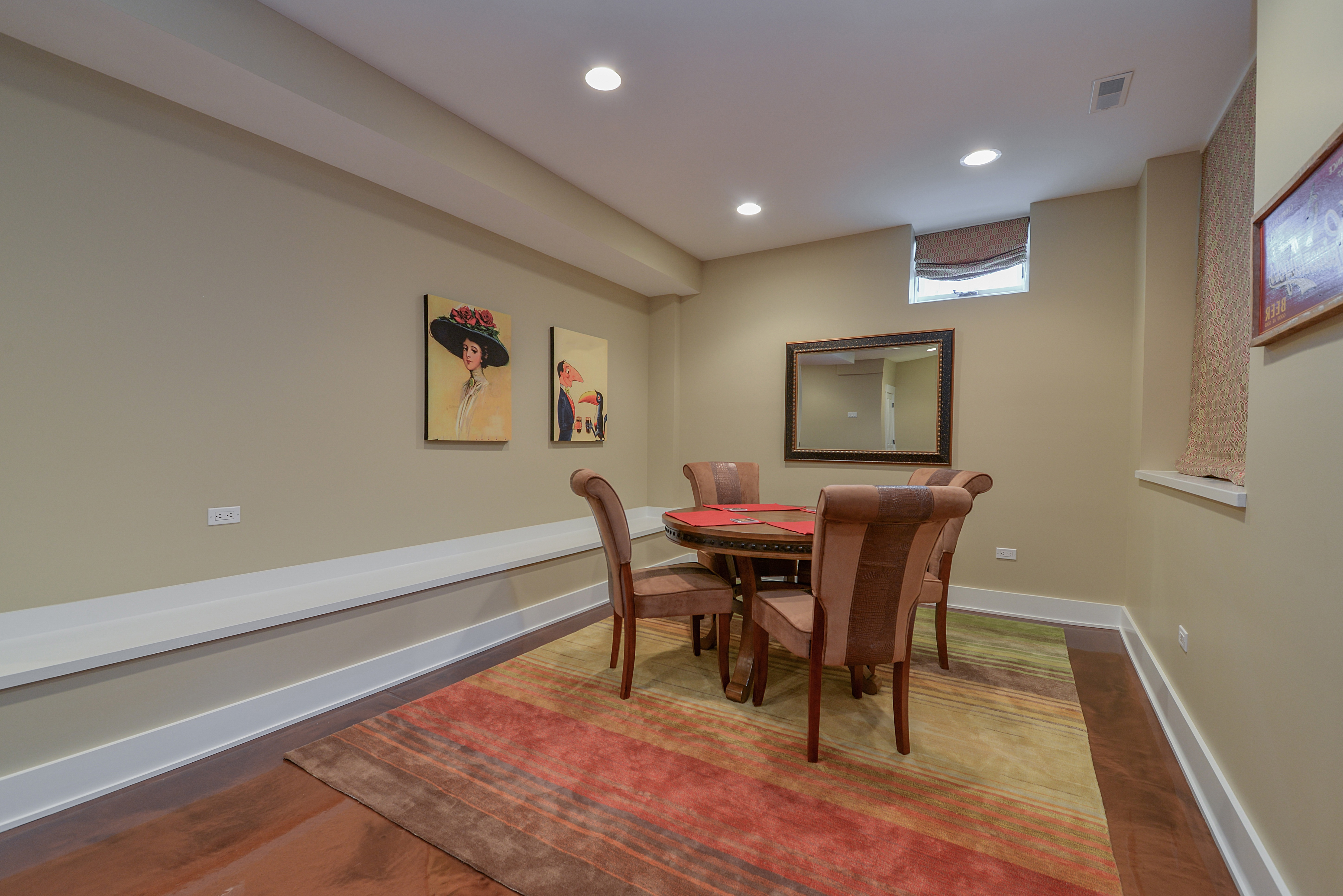 Colorful Striped Rug Under Circular Wood Dining Table (Image 3 of 32)