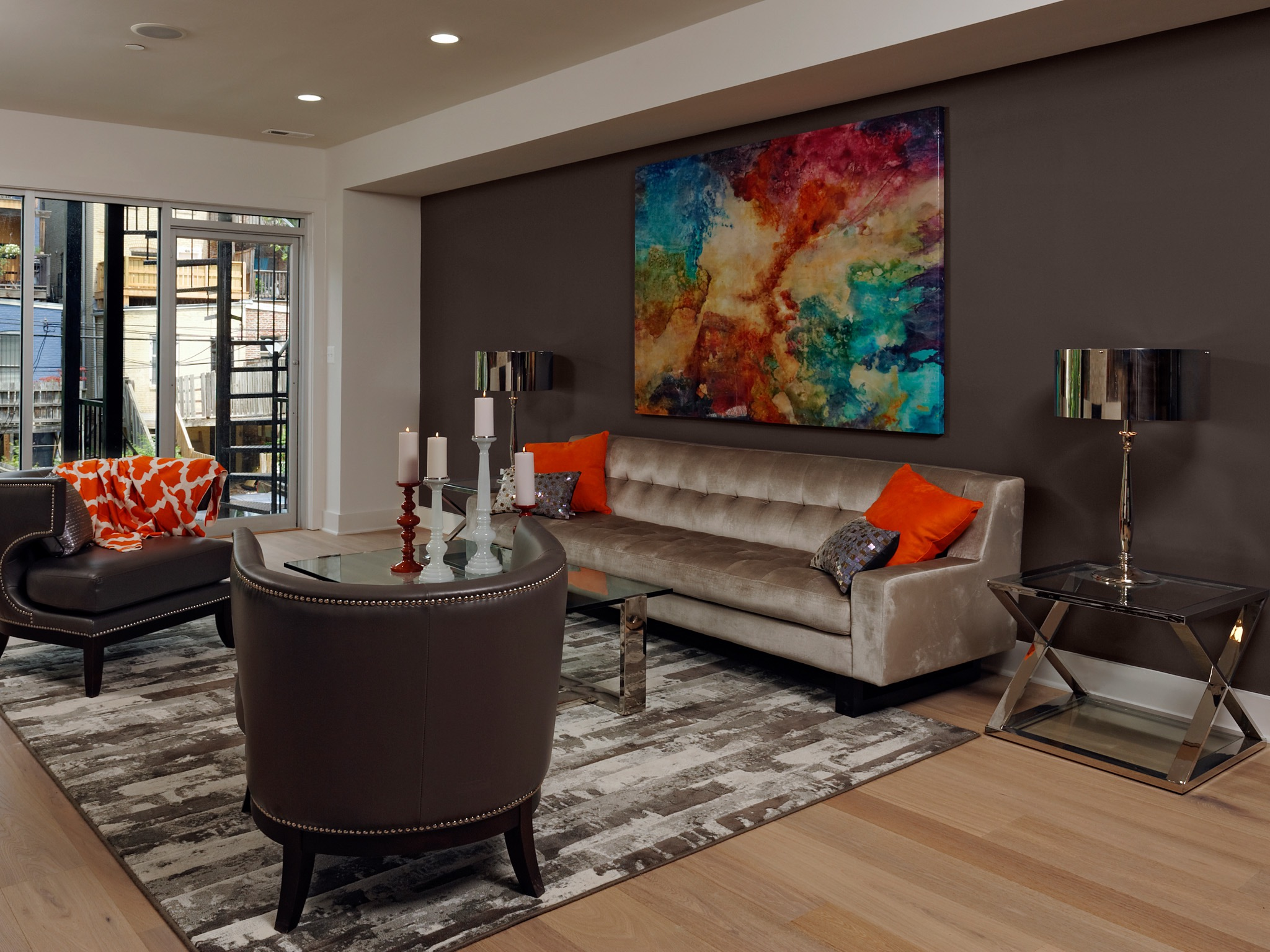 Contemporary Living Room With Abstract Art And Brown Wall (Image 4 of 30)