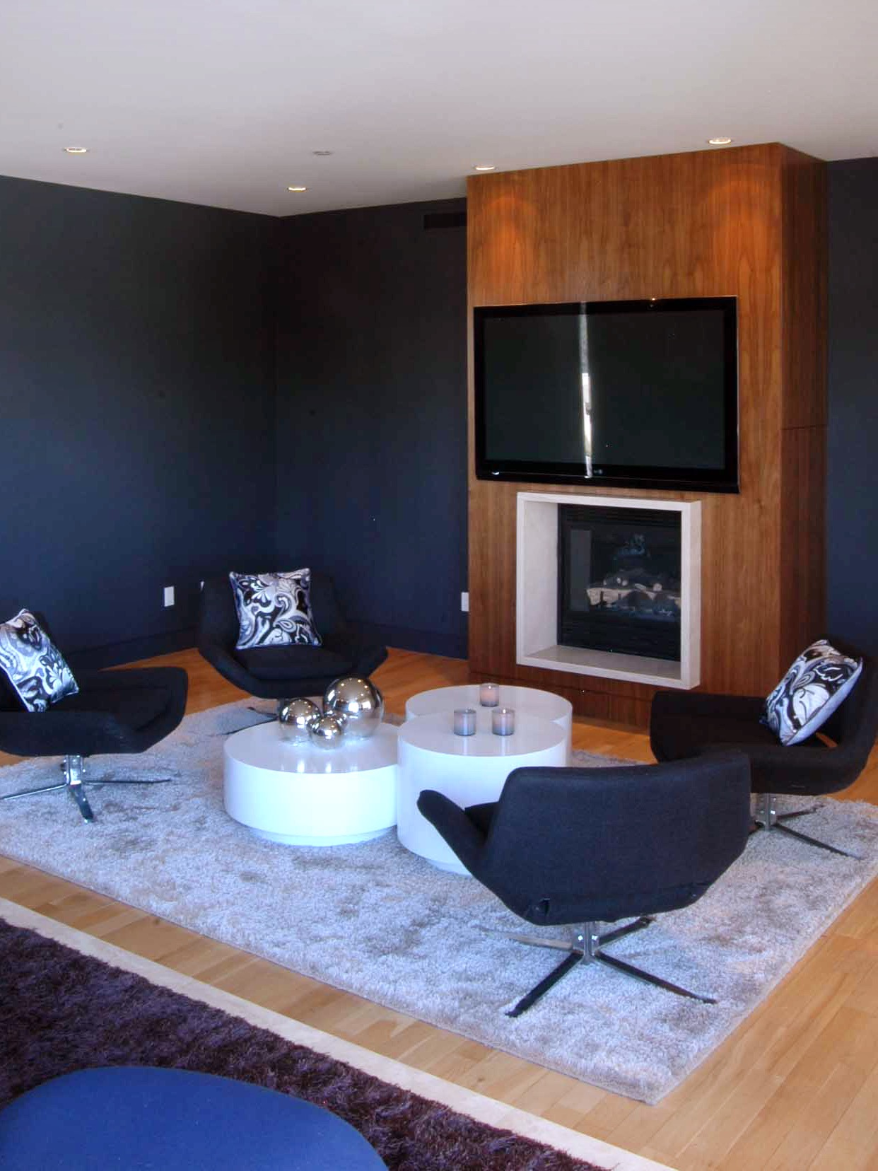 Contemporary Living Room With Futuristic Chairs And Modern Fireplace (Image 7 of 31)