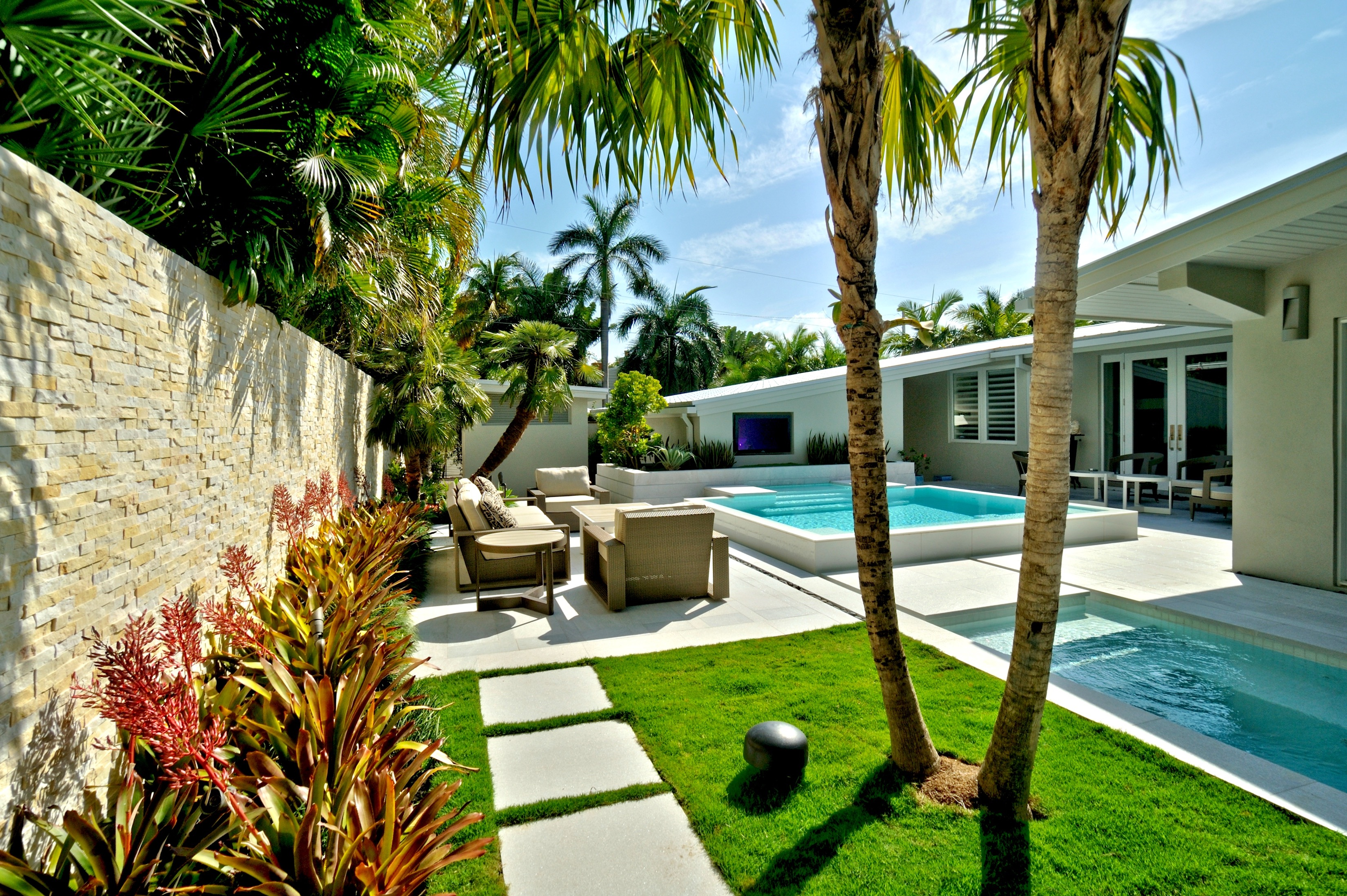 Contemporary Tropical Backyard Pool Area With Palms (Image 5 of 30)