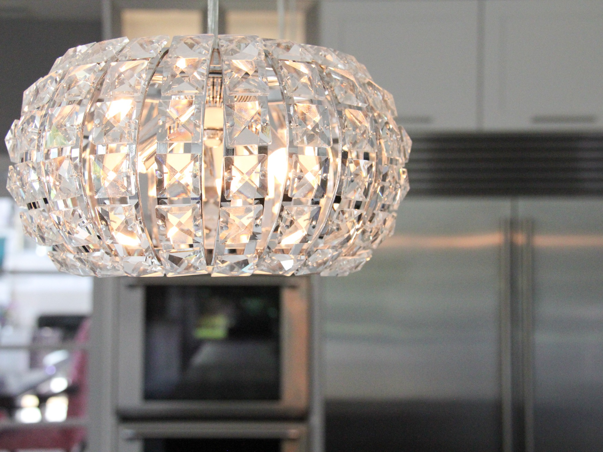 Crystal Pendant Lights Above Contemporary Kitchen Island (View 12 of 39)