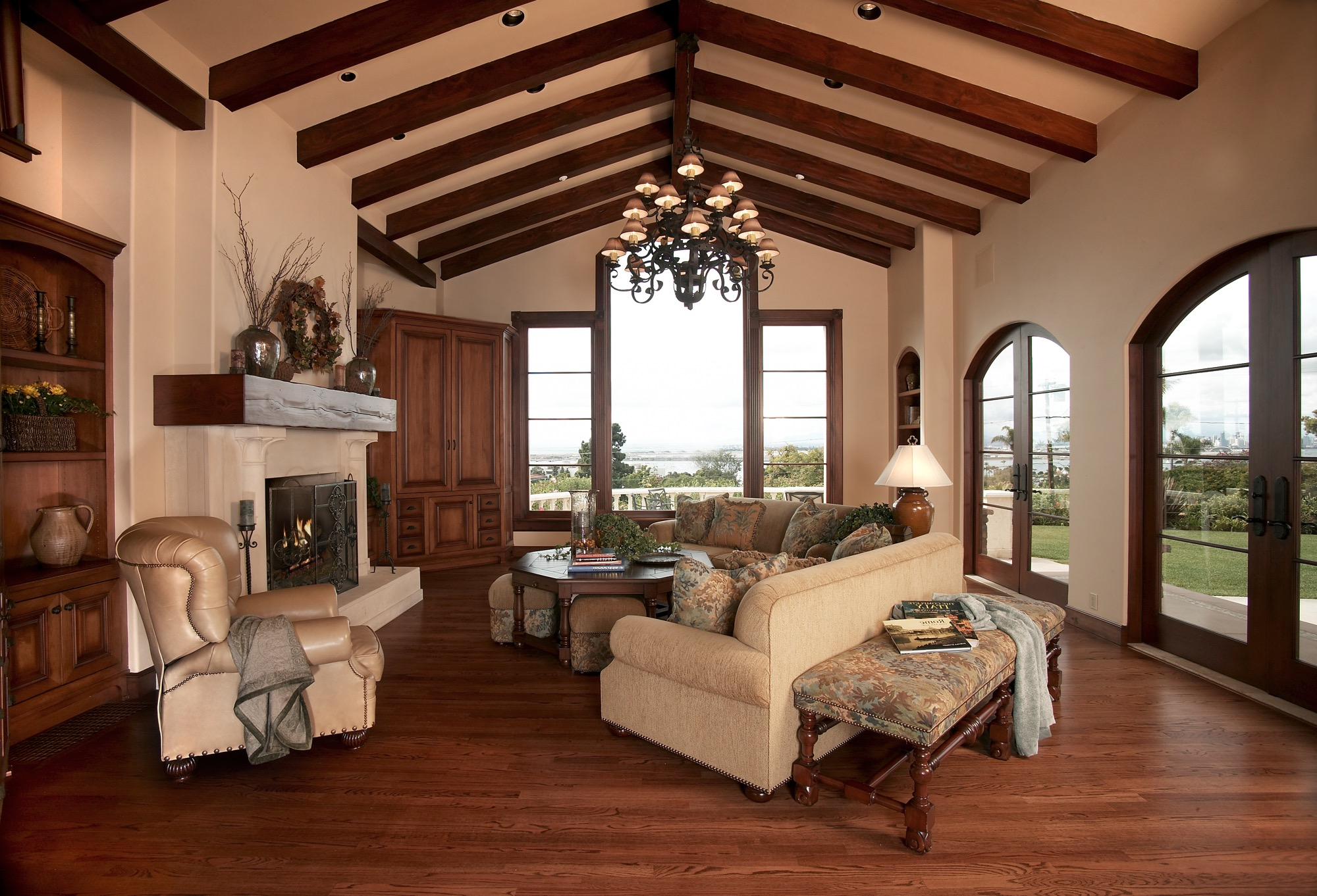 Italian Style Wooden Living Room With Exposed Wood Beams, Elegant Neutral Furniture And Hardwood Floor (Image 5 of 15)