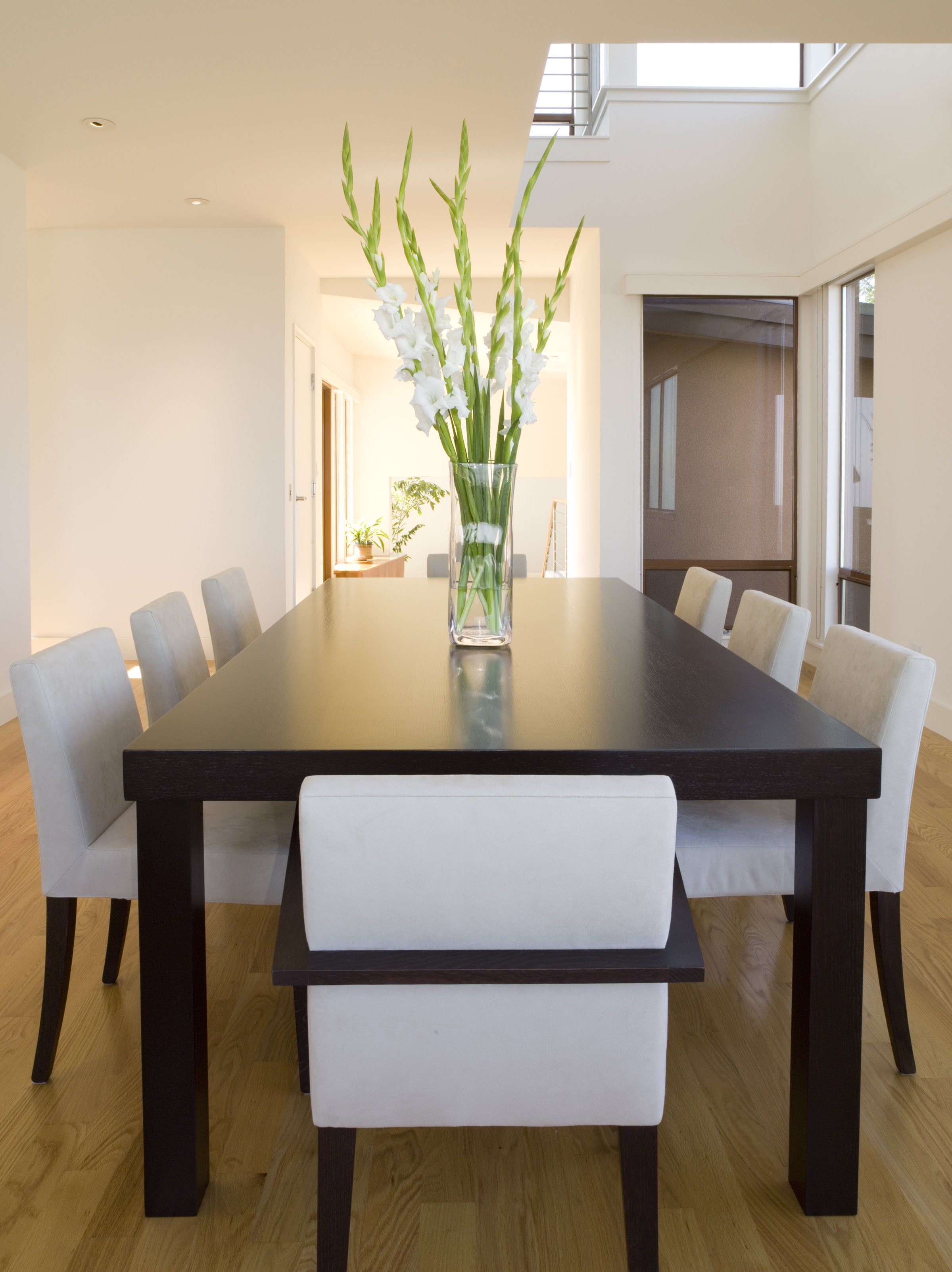 Light Filled Modern Dining Room With Sleek Dining Set (Image 9 of 30)