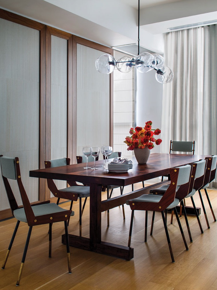 Midcentury Modern Dining Room With Globe Pendant Light And Wood Table (Image 10 of 30)