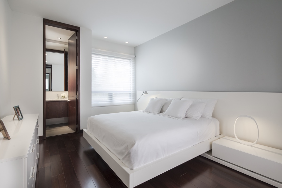 Minimalist White Apartment Bedroom With Bathroom (Photo 1 of 19)