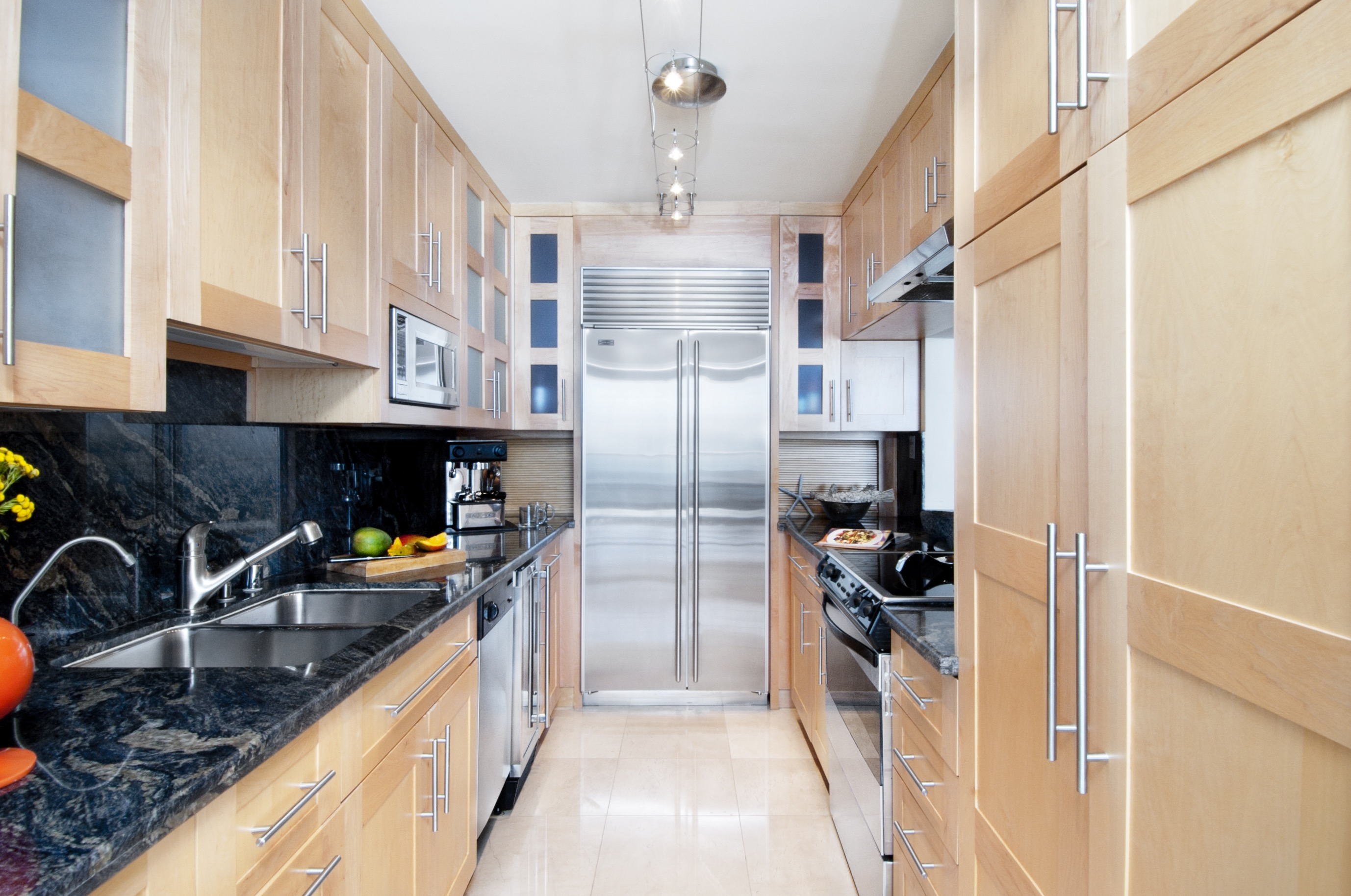 Modern Galley Apartment Kitchen With Natural Wood Cabinetry (View 21 of 30)