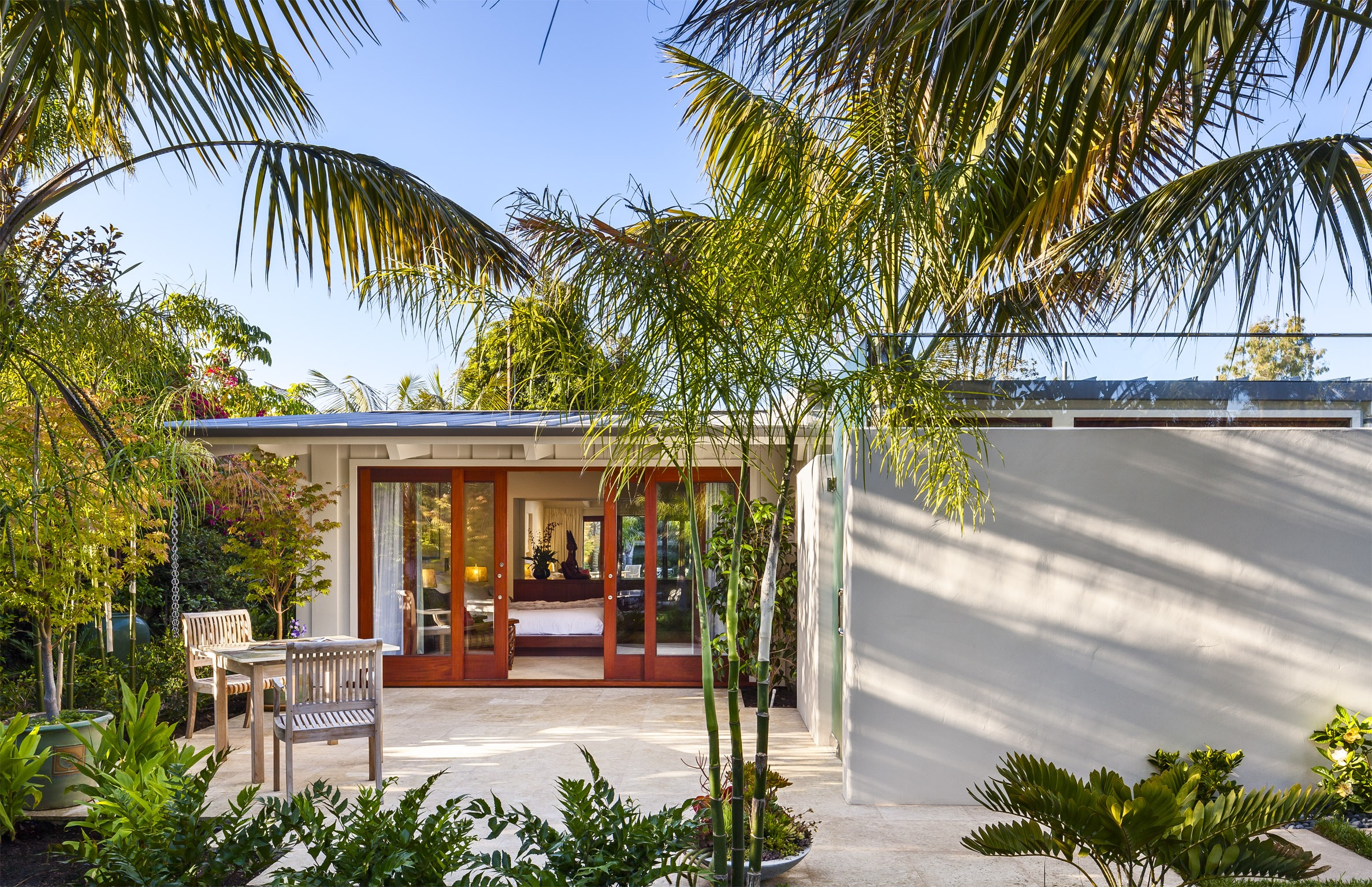 Modern Outdoor Patio With Tropical Landscaping (Image 14 of 30)