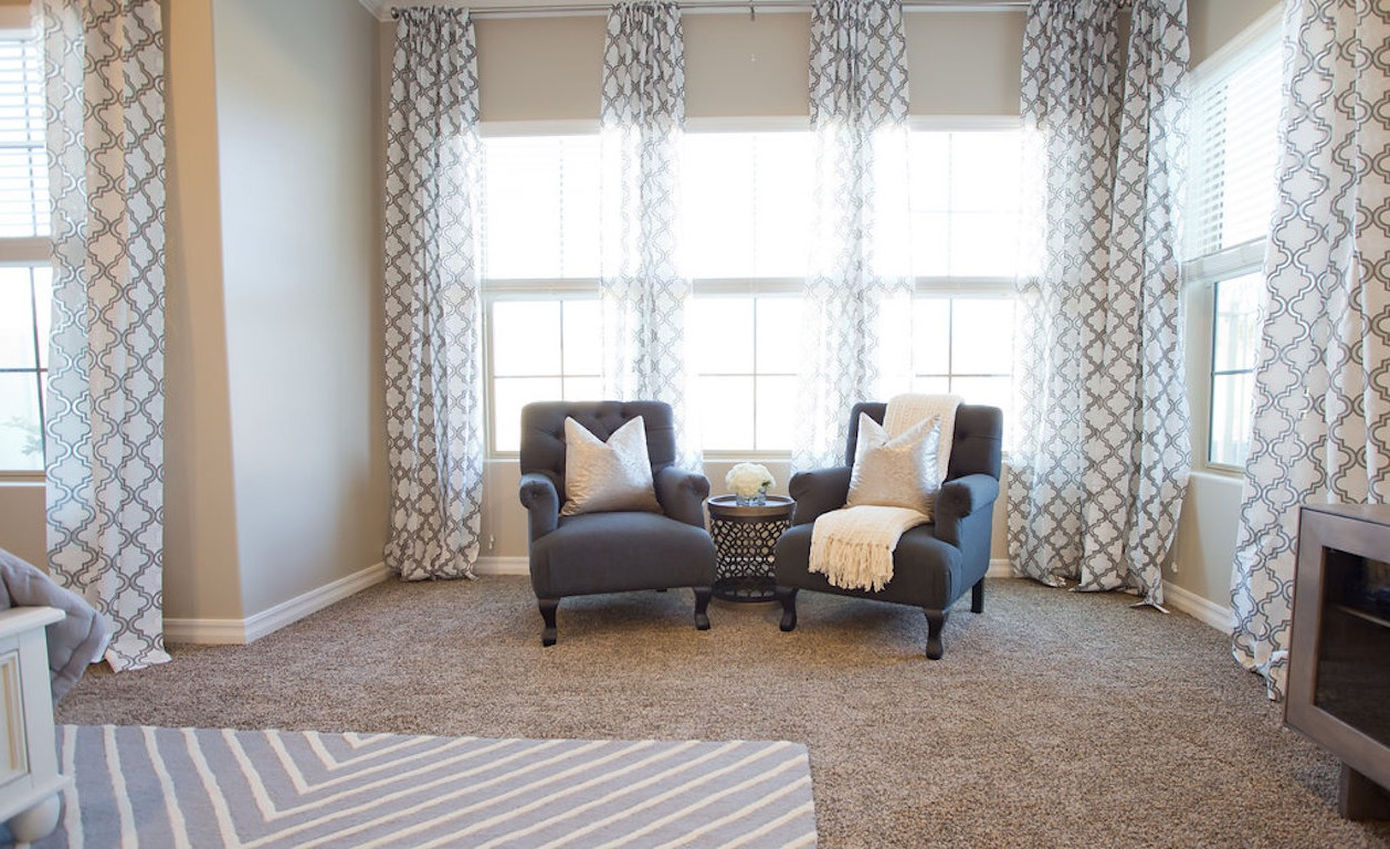 Neutral Sitting Room With Graphic Curtains (Image 24 of 35)