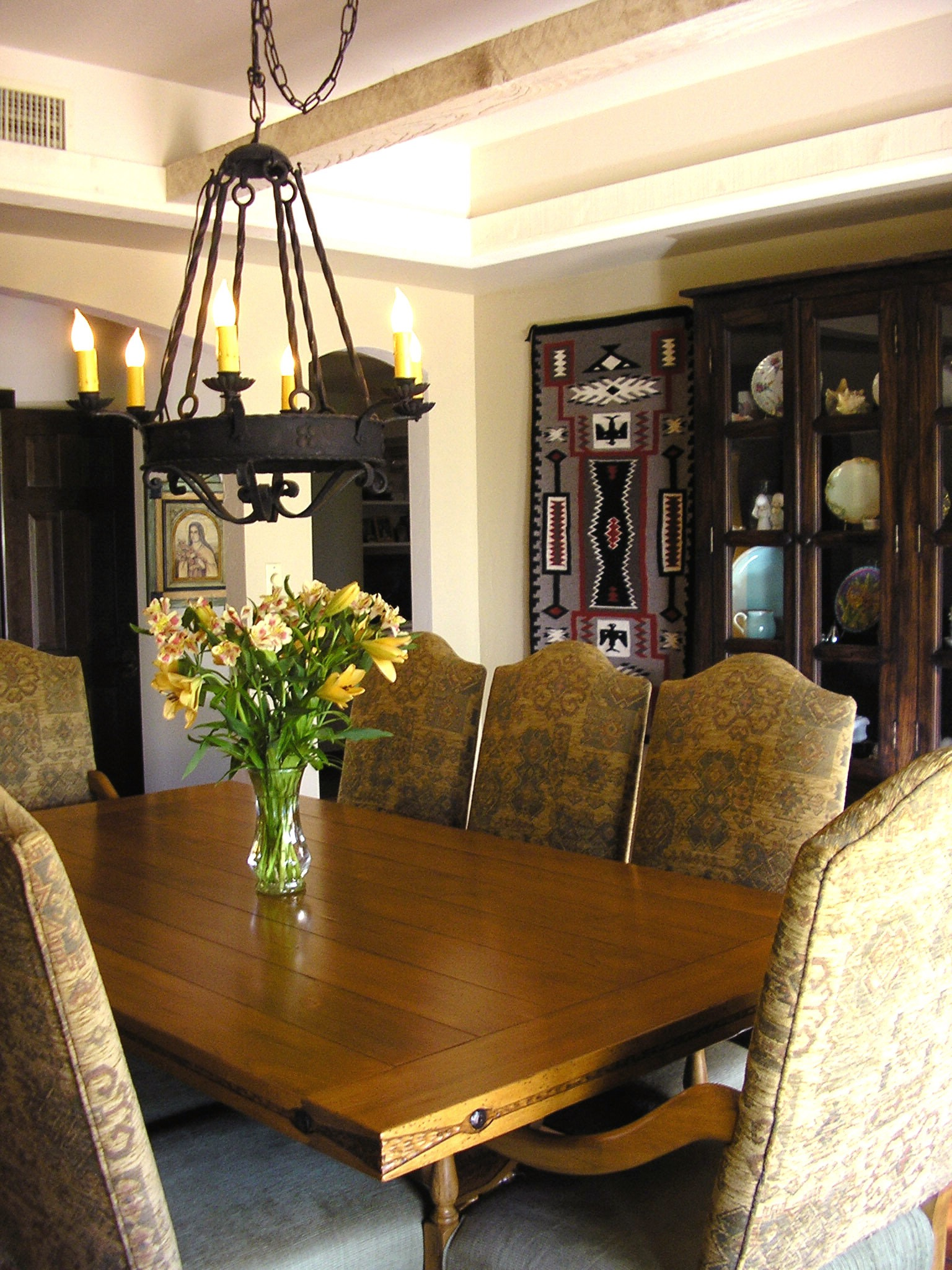 Neutral Southwestern Dining Room With Iron Chandelier (Image 7 of 11)