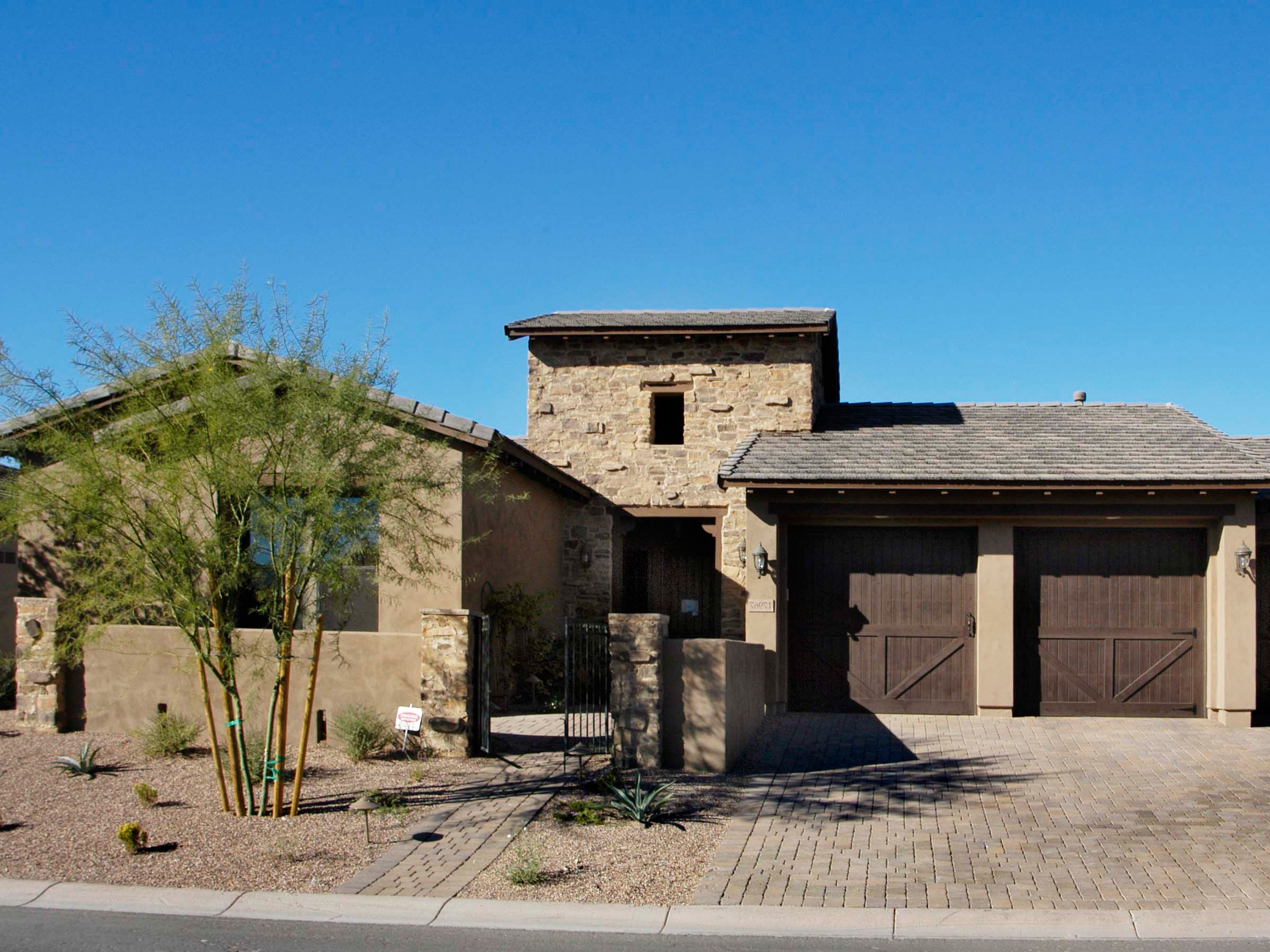 Southwestern Home Garage With Stucco And Stone Facade (Image 31 of 38)
