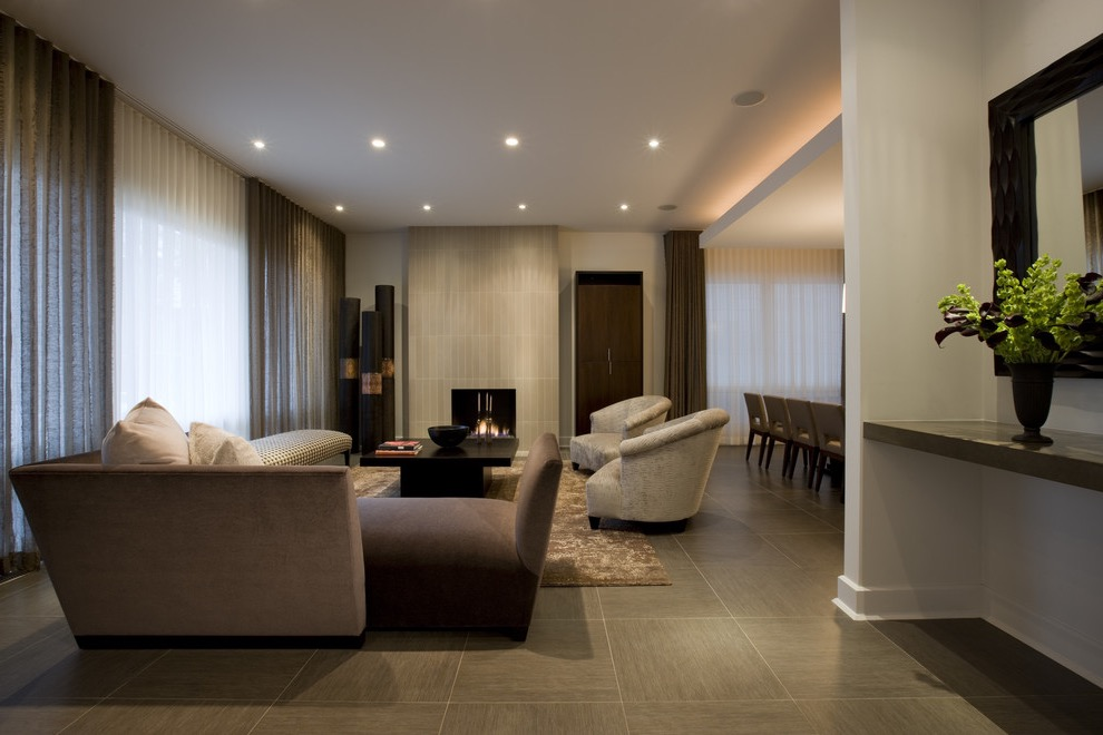 Trendy Luxury Living Room With A Tile Fireplace Surround And Porcelain Floors (Image 30 of 32)