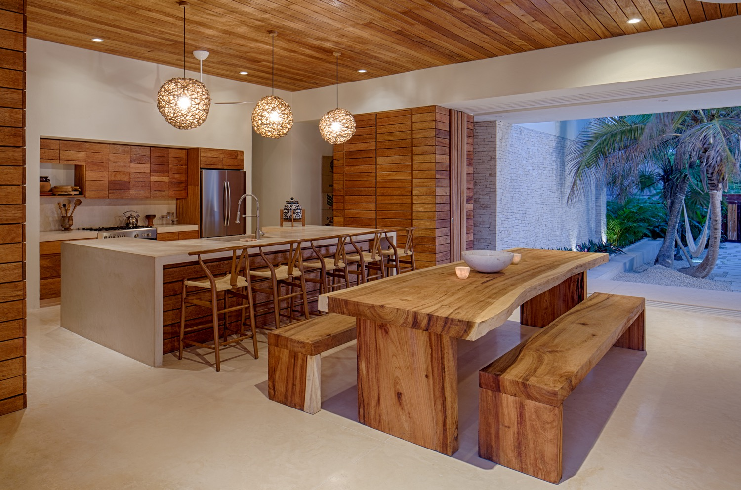 Wood Paneled Kitchen And Dining Room With Wood Table (Image 10 of 15)