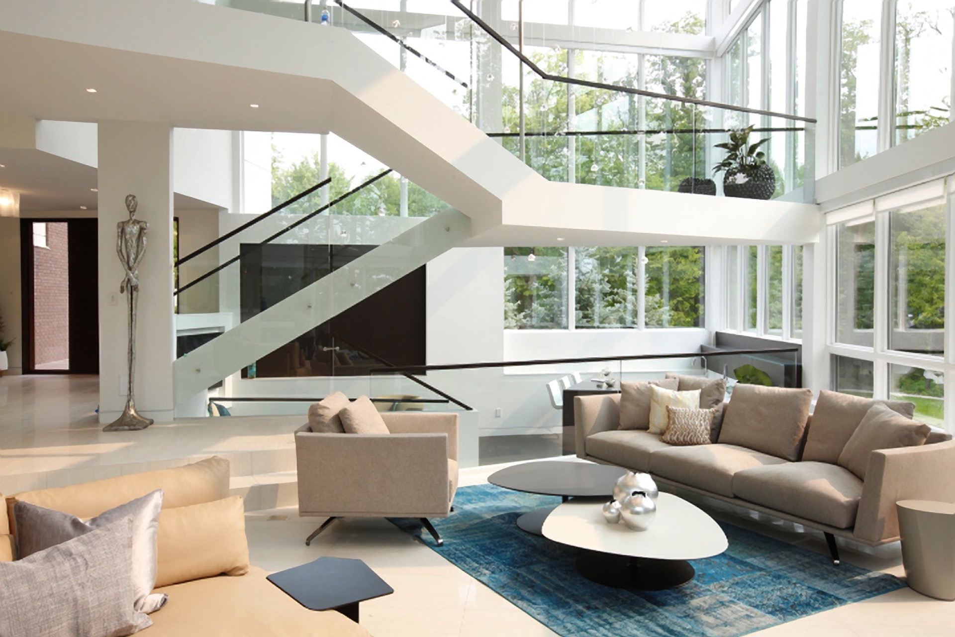 Contemporary Living Room With Large Glass Windows (View 6 of 31)