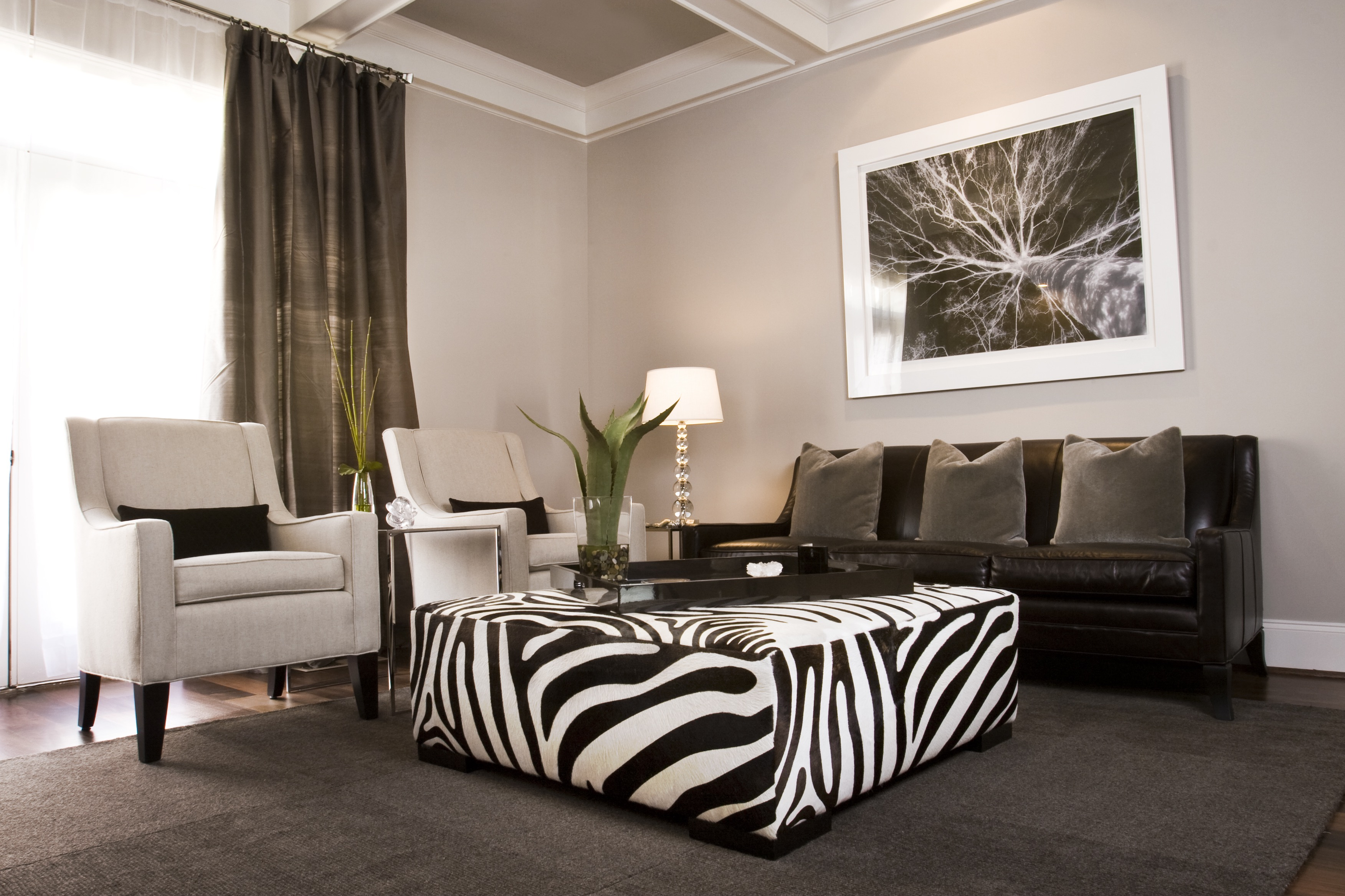 Gray Living Room Wall Color Features A Zebra Print Ottoman, A Black Leather Sofa And A Pair Of White Chairs (Image 10 of 20)