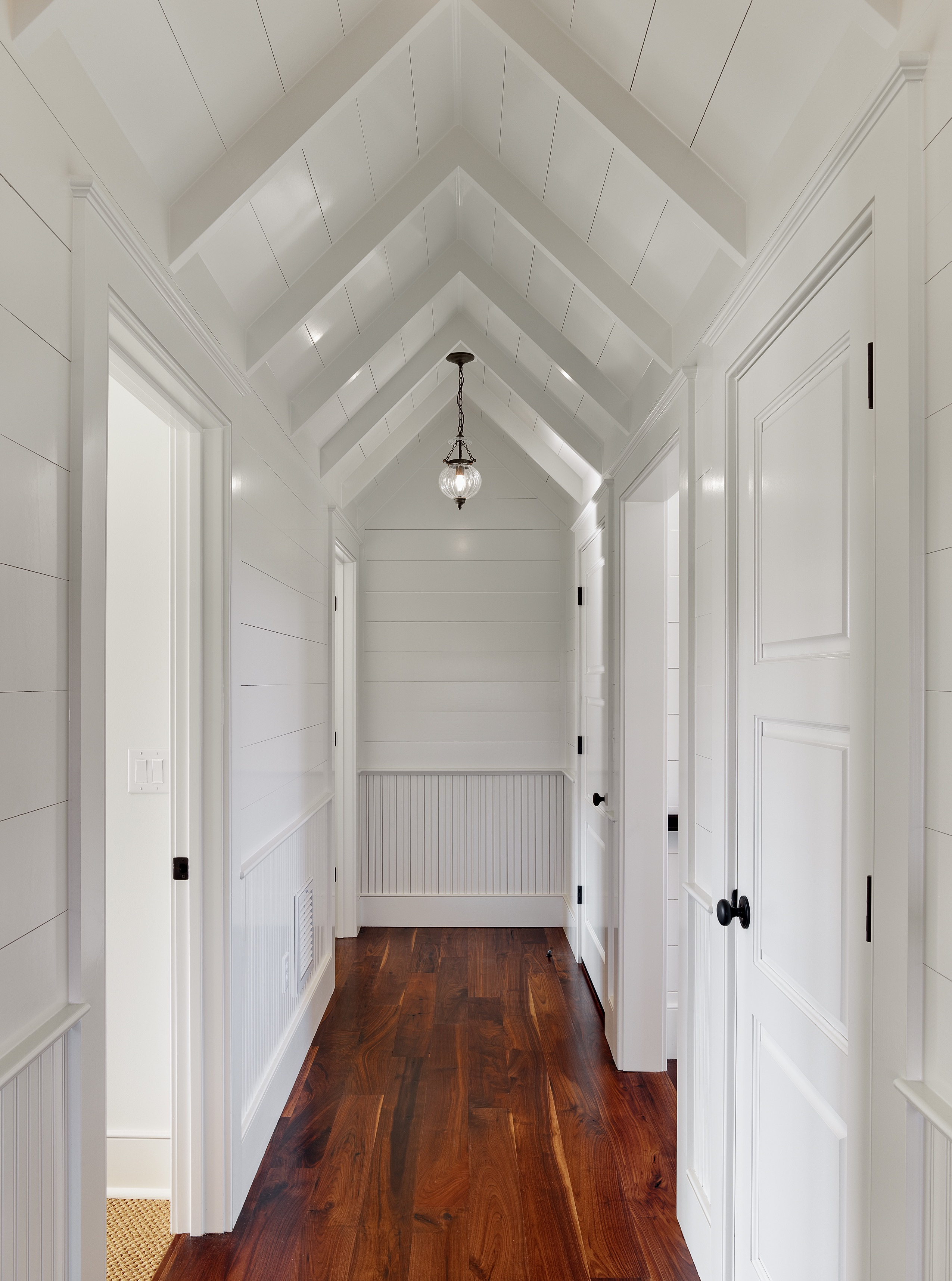 Modern Angled Ceiling With White Paneling And Subtle White Beams (View 3 of 31)