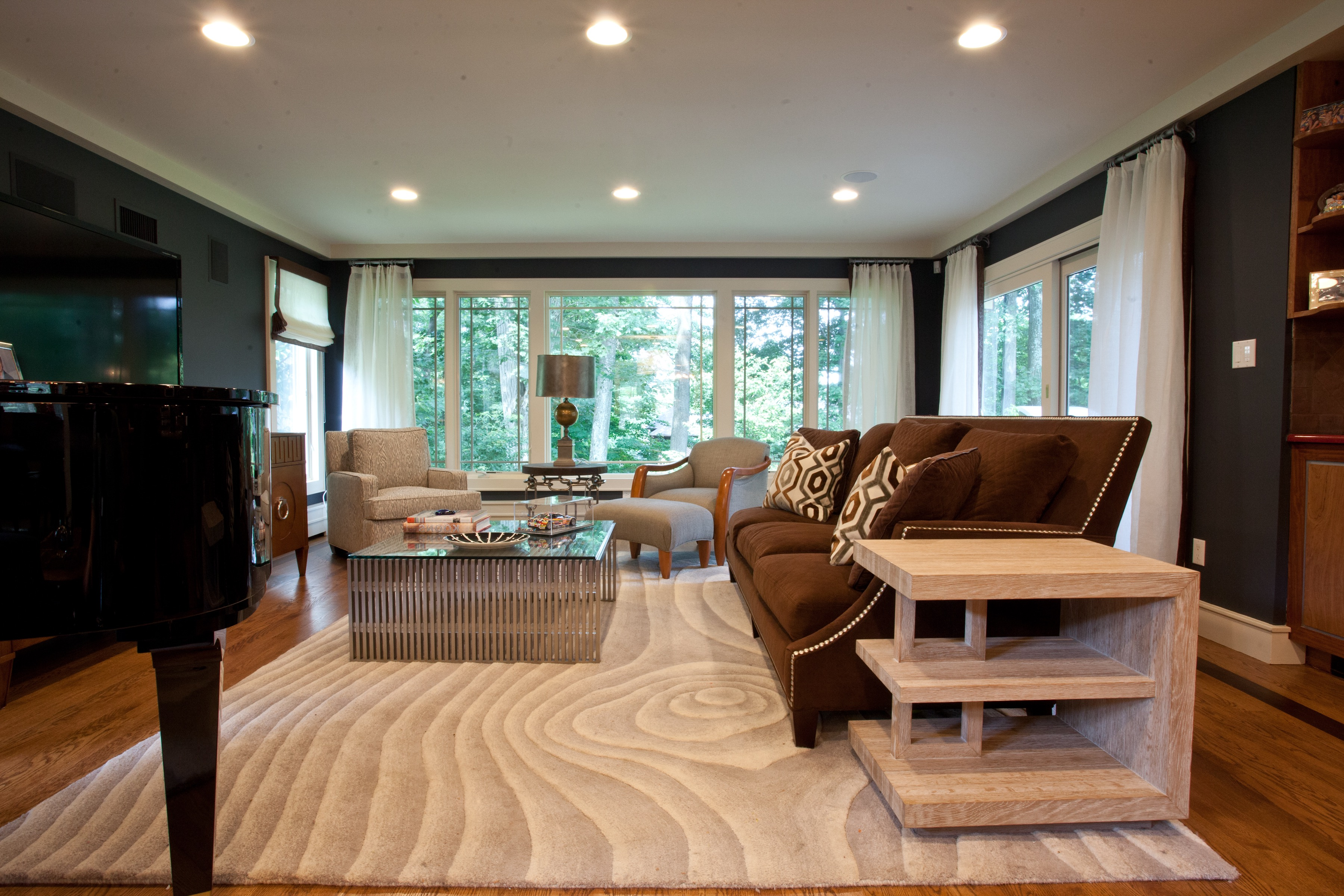 Modern Art Decor Inspired Living Room With Living Room With Swirl Pattern Area Rug (View 20 of 20)