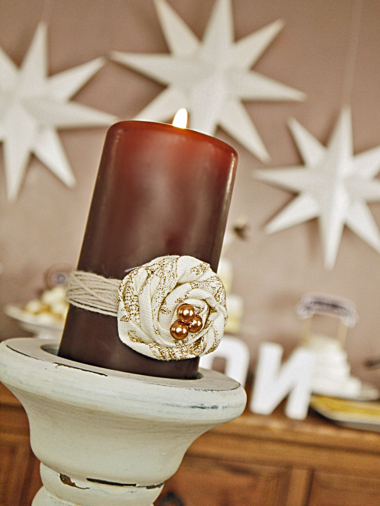 Candle Centerpiece With Rolled White Rose Decoration (Image 1 of 20)
