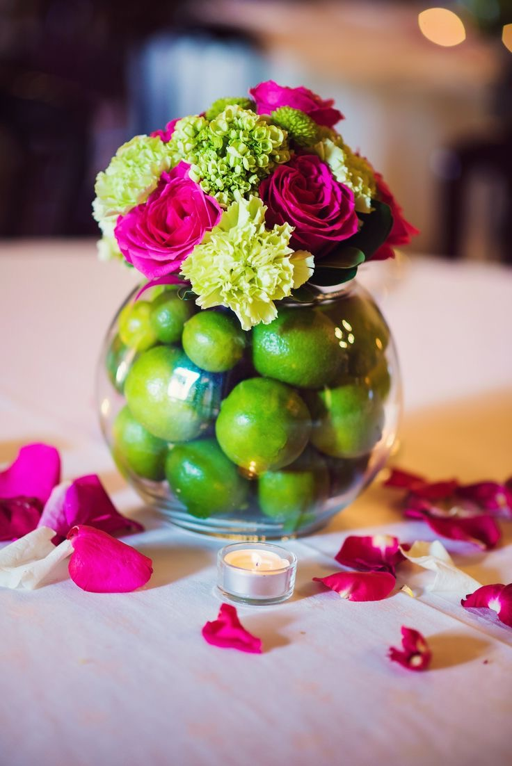 15 beauty pink and green wedding centerpieces 19314 beautiful limes and hot pink flower petals in glass vase wedding centerpiece image 2 of reviewsmspy