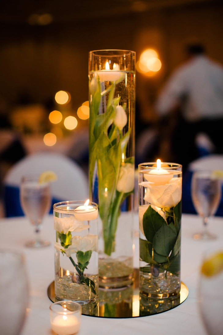 Beauty Flowers Submerged In Water With Candle Centerpiece (Image 1 of 10)