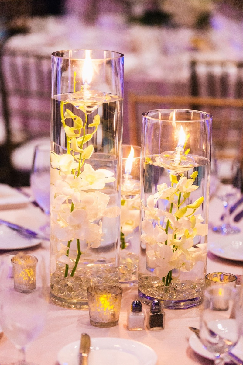 Beauty Submerged Orchids With Floating Candles Wedding Centerpieces Photo 3 Of 10