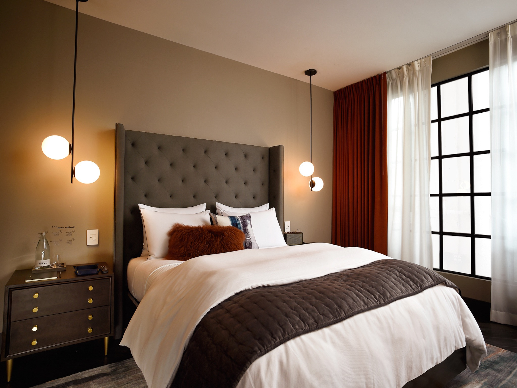 Modern Hotel Style Apartment Bedroom With Globe Pendants And Tufted Headboard (Image 21 of 25)