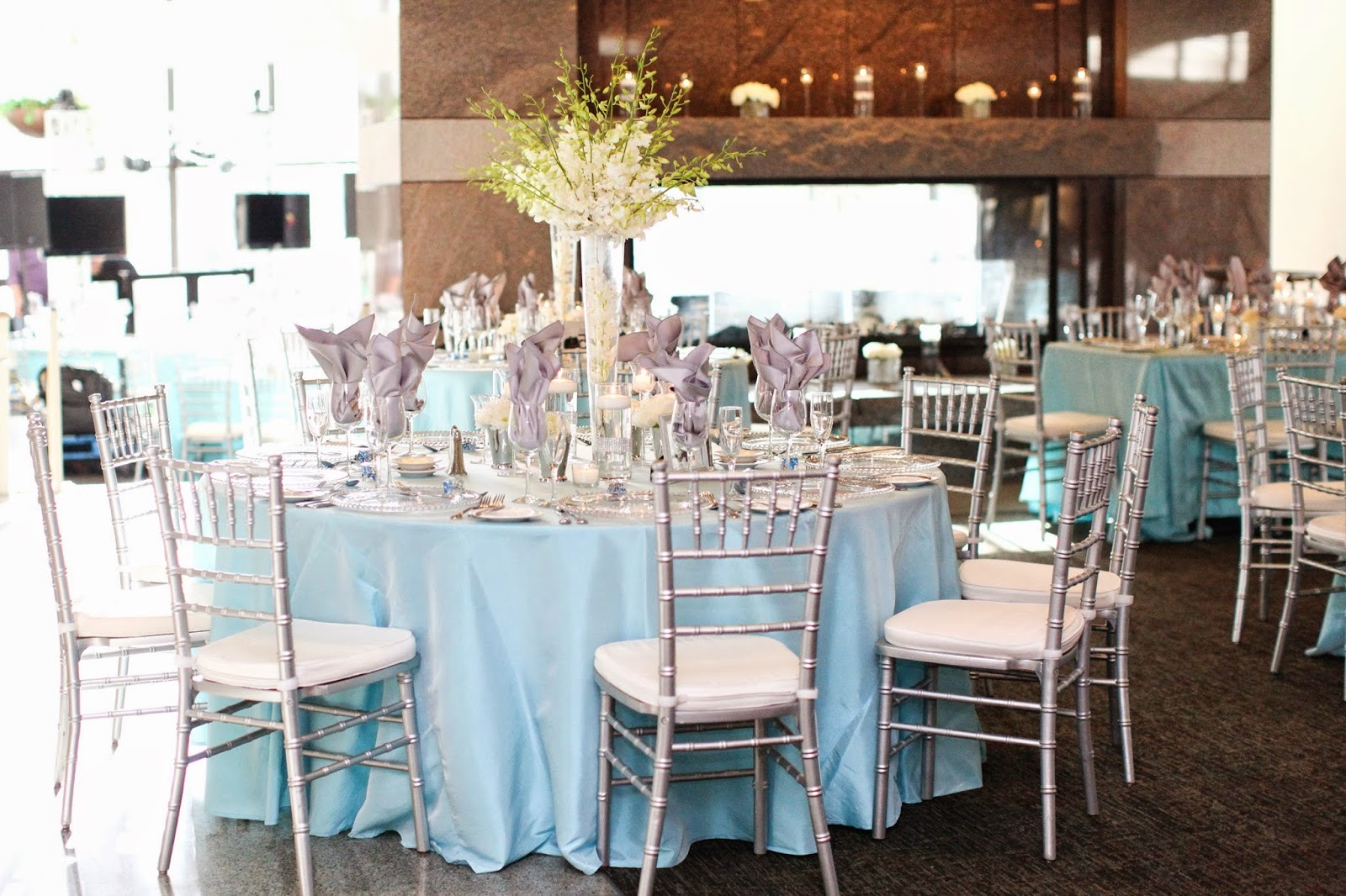 Round Table Wedding Decor With Tall Flower Centerpiece (Image 14 of 30)