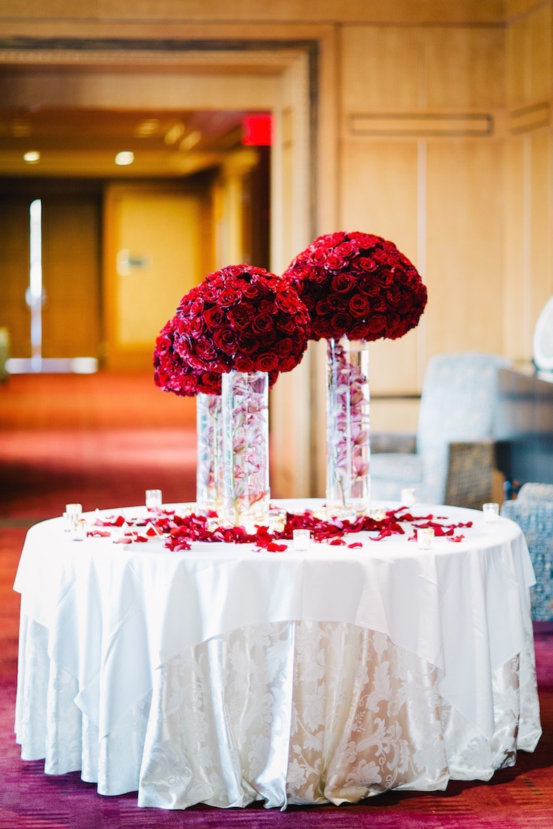 Wedding Centerpieces With Red Flowers And Submerged Pink Orchid Stems In Cylinder Vases (Image 9 of 10)