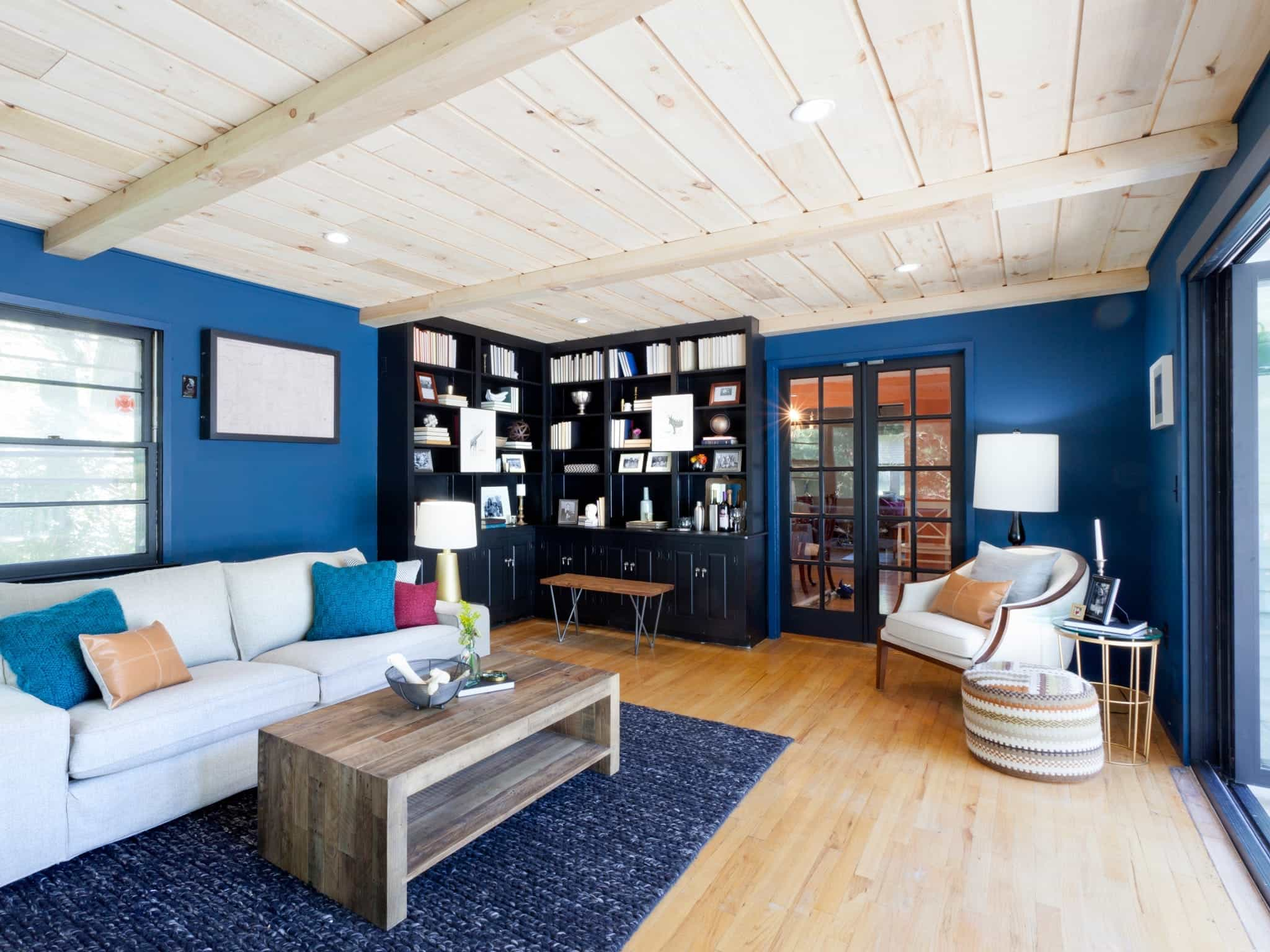 2017 Blue Contemporary Living Room With Black Corner Bookcases (Image 1 of 29)