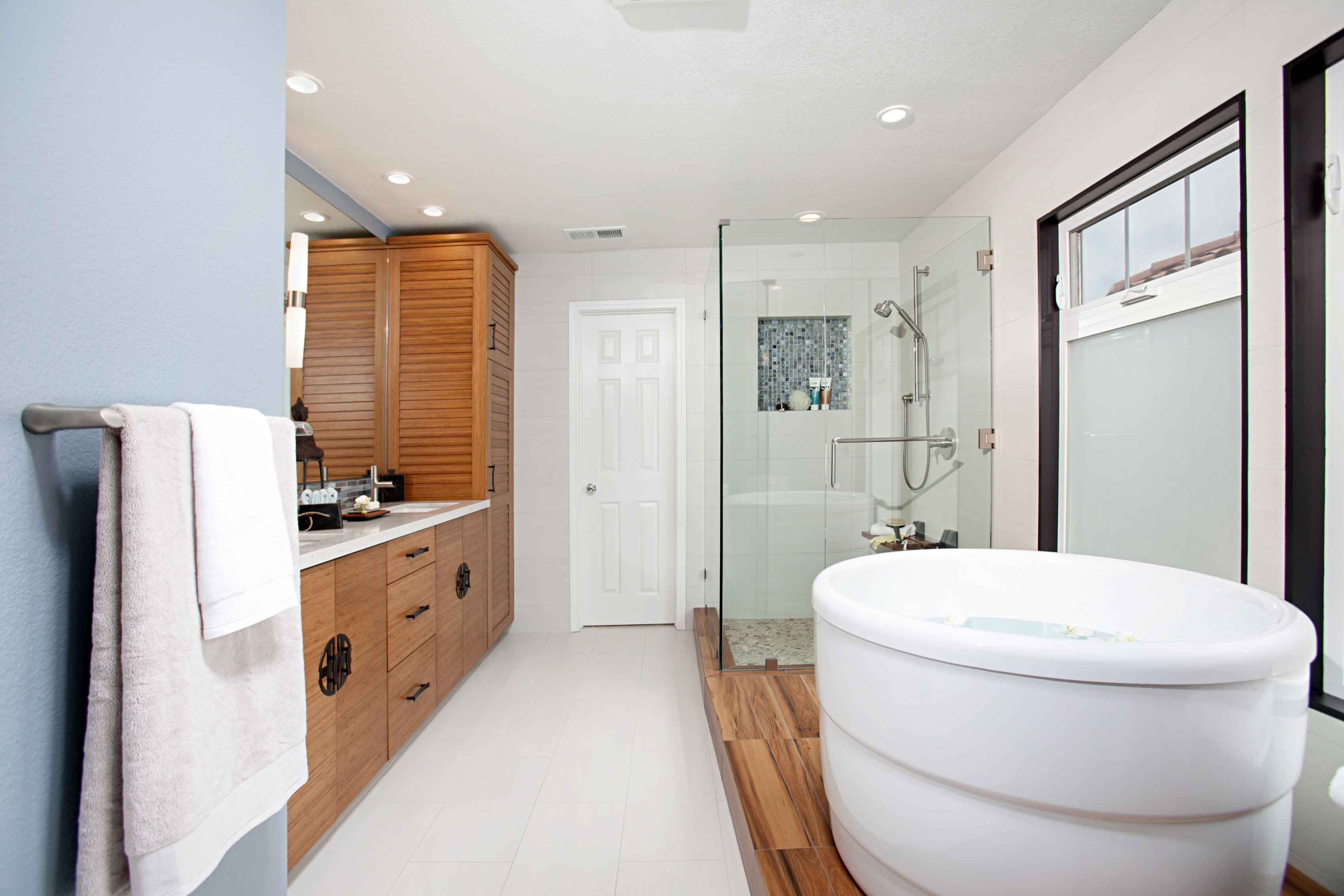 Asian Master Bathroom With White Bowl Bathtub Combo With Glass Enclosed Shower And Sleek Wood Details (Image 2 of 16)