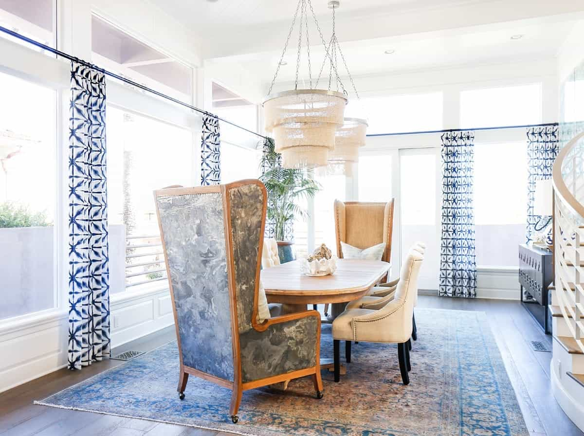 Blue And White Eclectic Dining Room With Tall Wingback Chairs And Antique Carpet Flooring (Photo 2 of 13)
