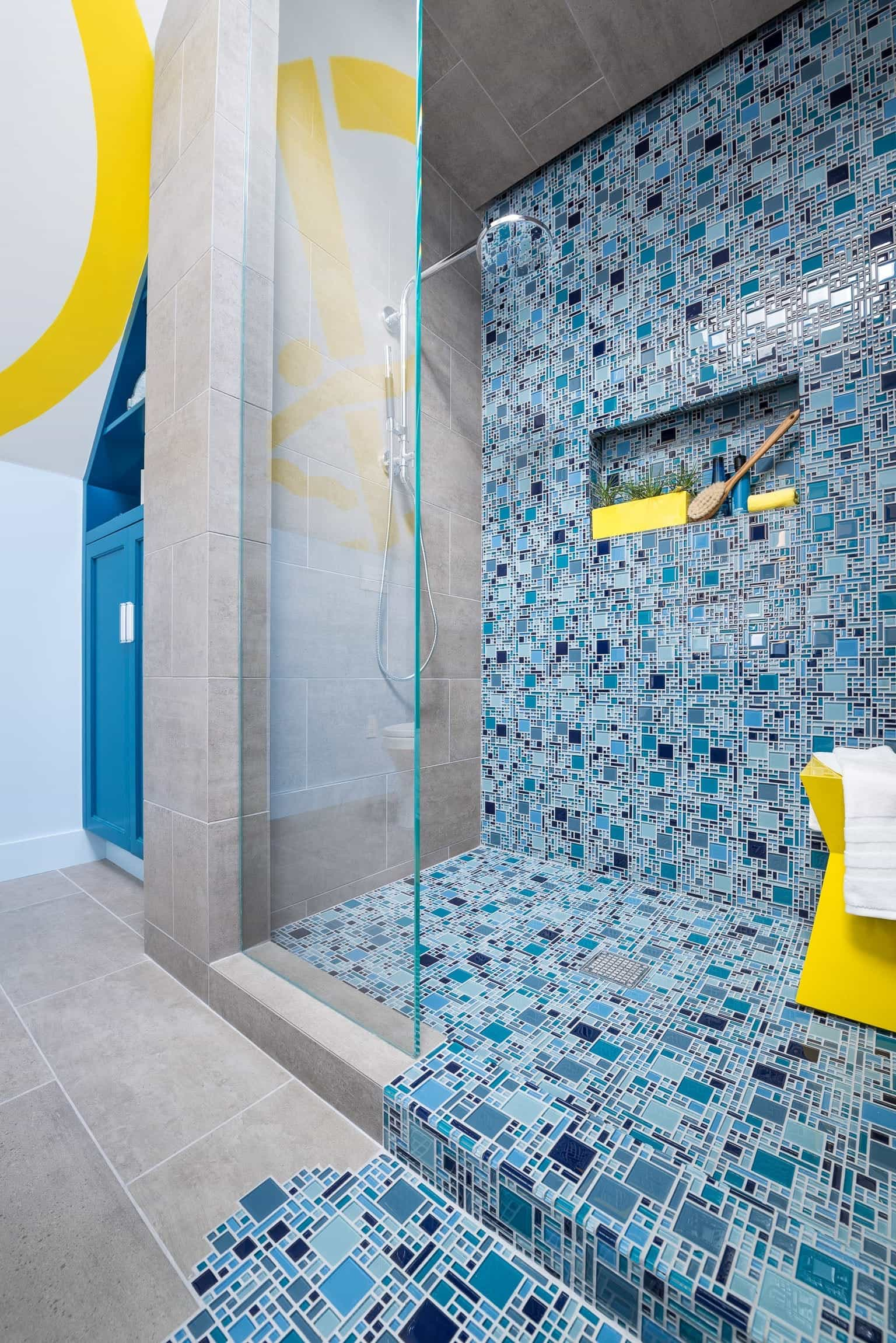 Blue Mosaic Tile Spills From Bathroom Shower Onto Floor (View 16 of 20)