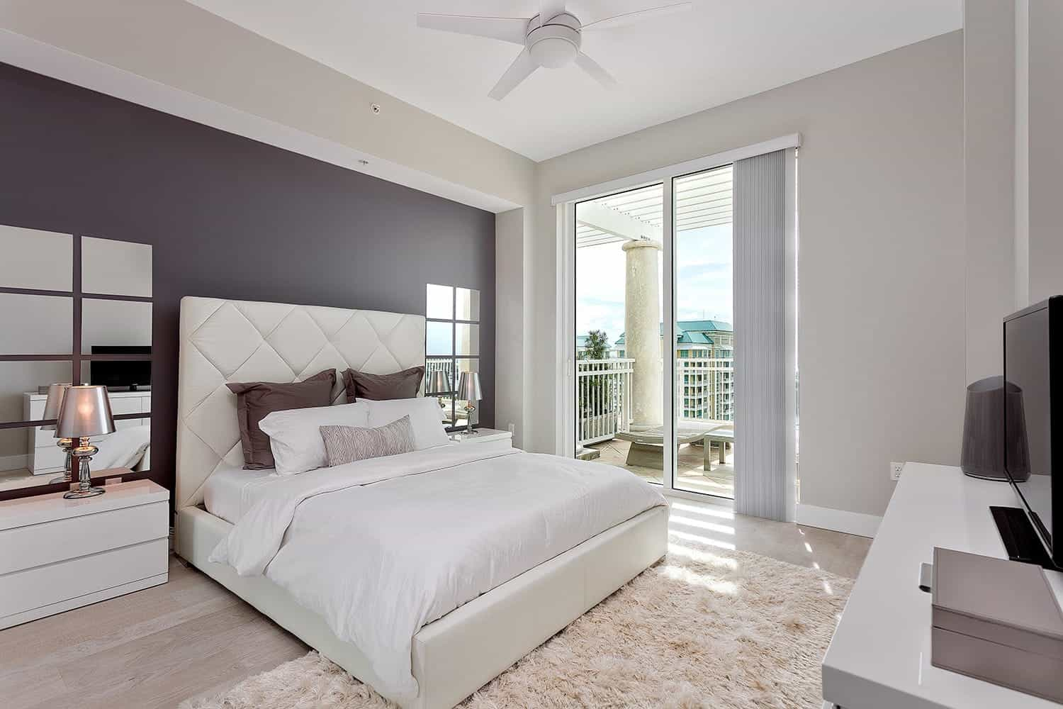 Bright Contemporary Bedroom Cheap Decoration With Purple Gray Accent Wall, Tufted White Headboard And Mirror Wall Paneling (View 11 of 16)