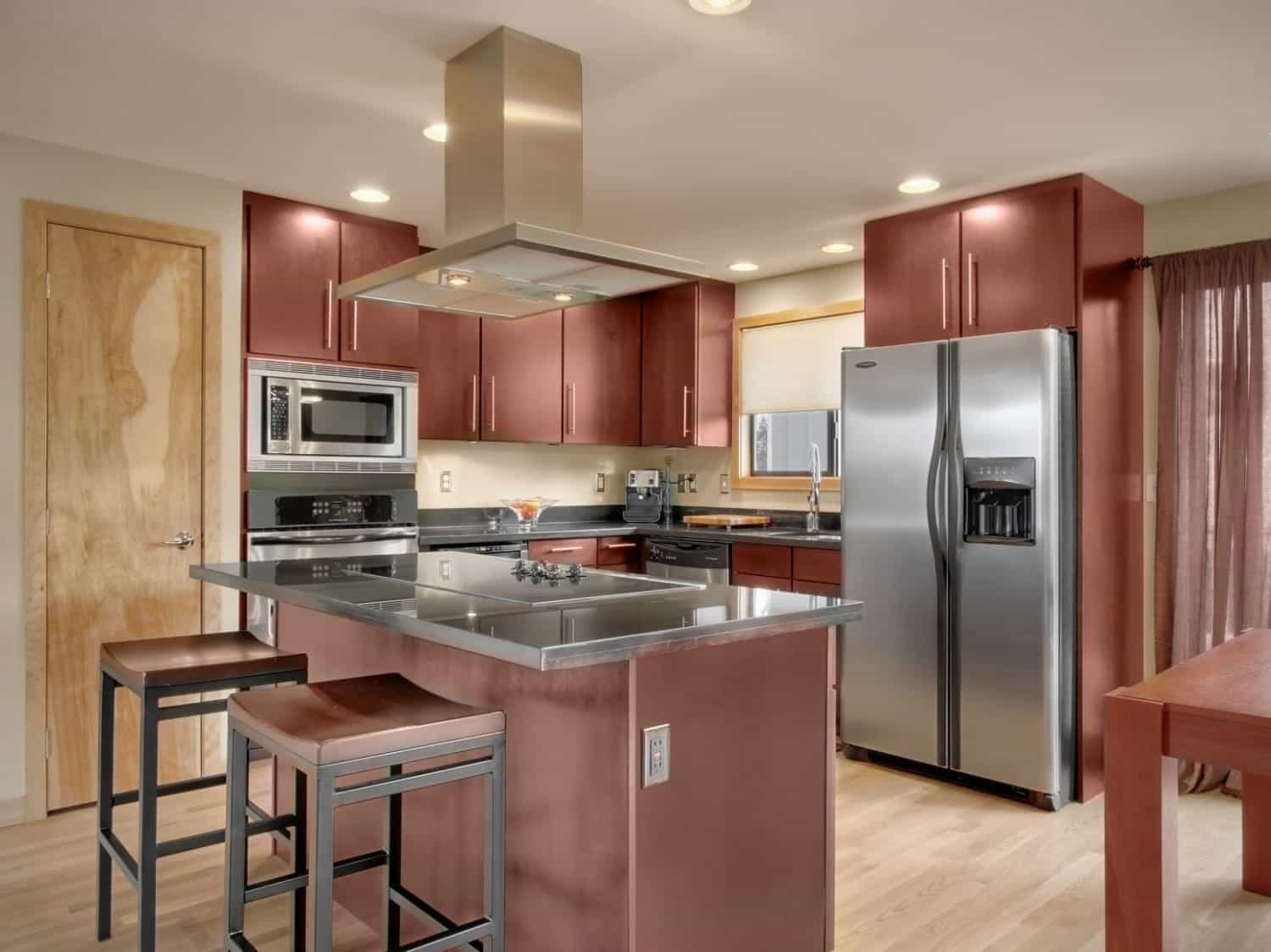 Bright Modern Kitchen Boasts Dark Cherry Wood Cabinets (Photo 9 of 26)