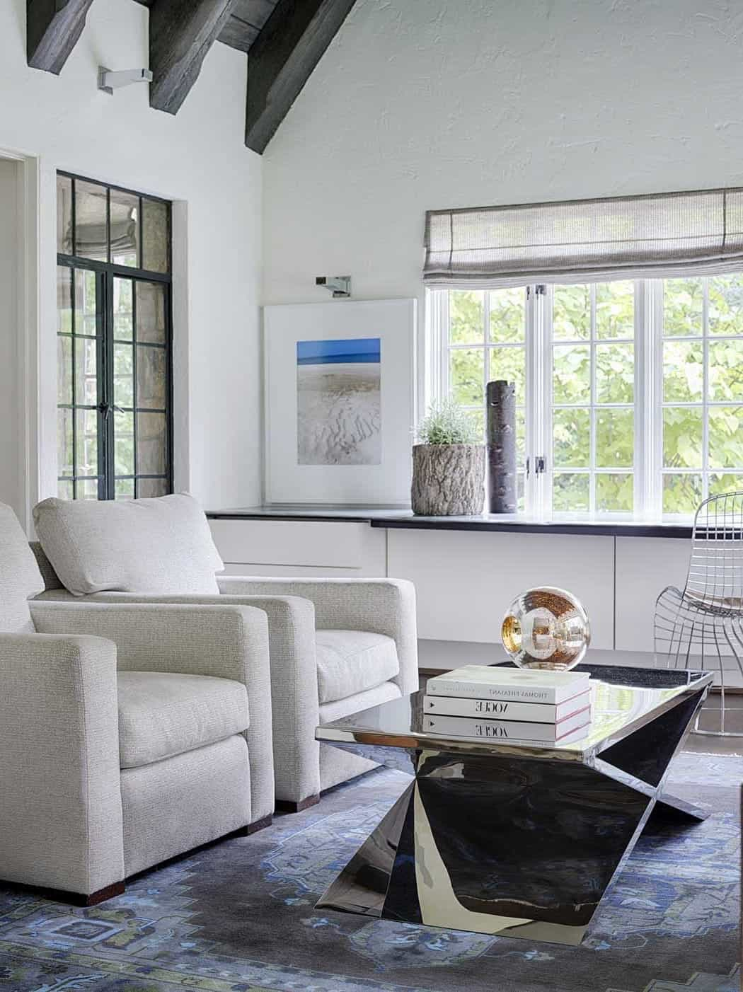 Bright Sunroom With Reflective Coffee Table (Image 7 of 32)