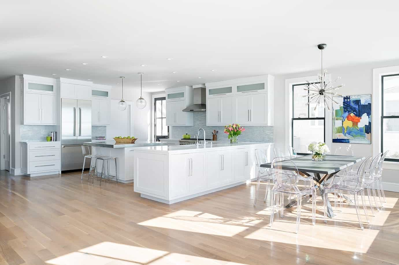 Bright White Open Kitchen And Dining Room With Oak Floors (Image 4 of 12)