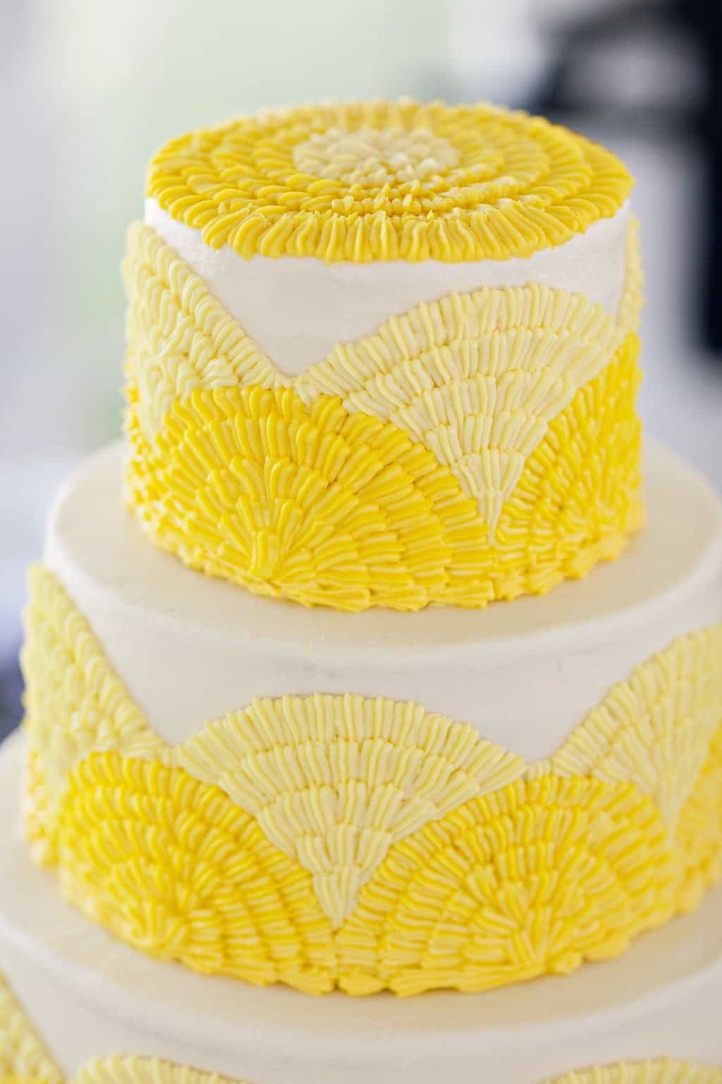 Bright Yellow And White Classic Wedding Cake (Image 2 of 16)