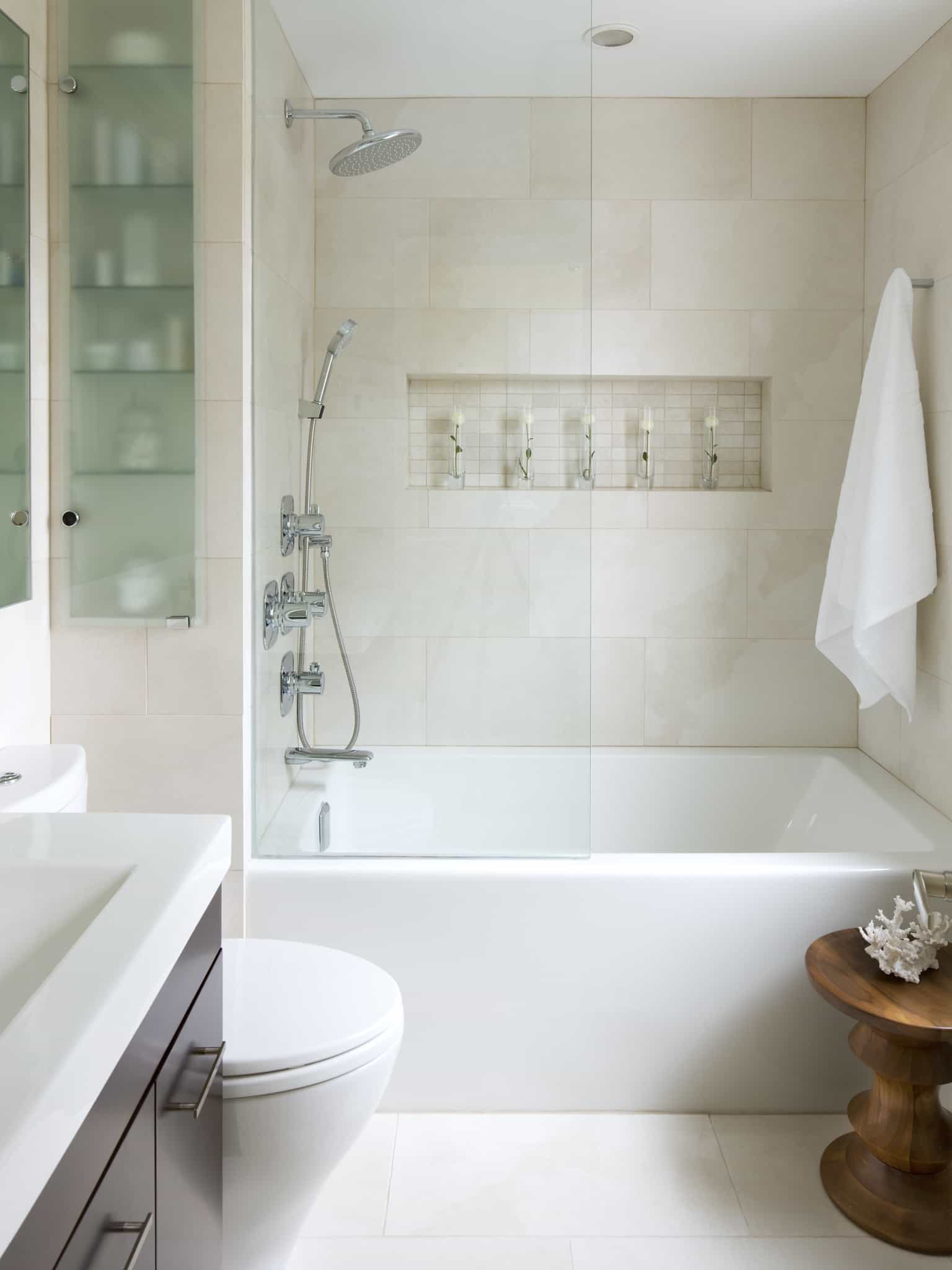 Chic White Bathroom With Sleek Cabinets (Image 11 of 29)