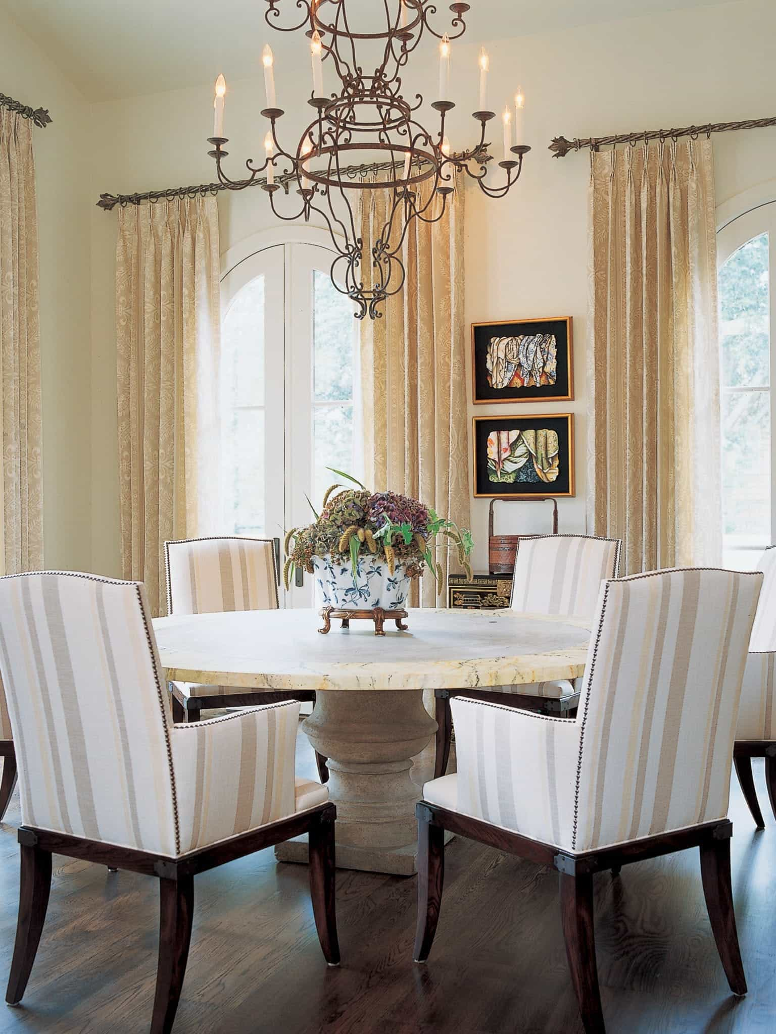 Classic Italian Dining Room With Ornate Chandelier And Round Marble Dining Table (View 13 of 25)