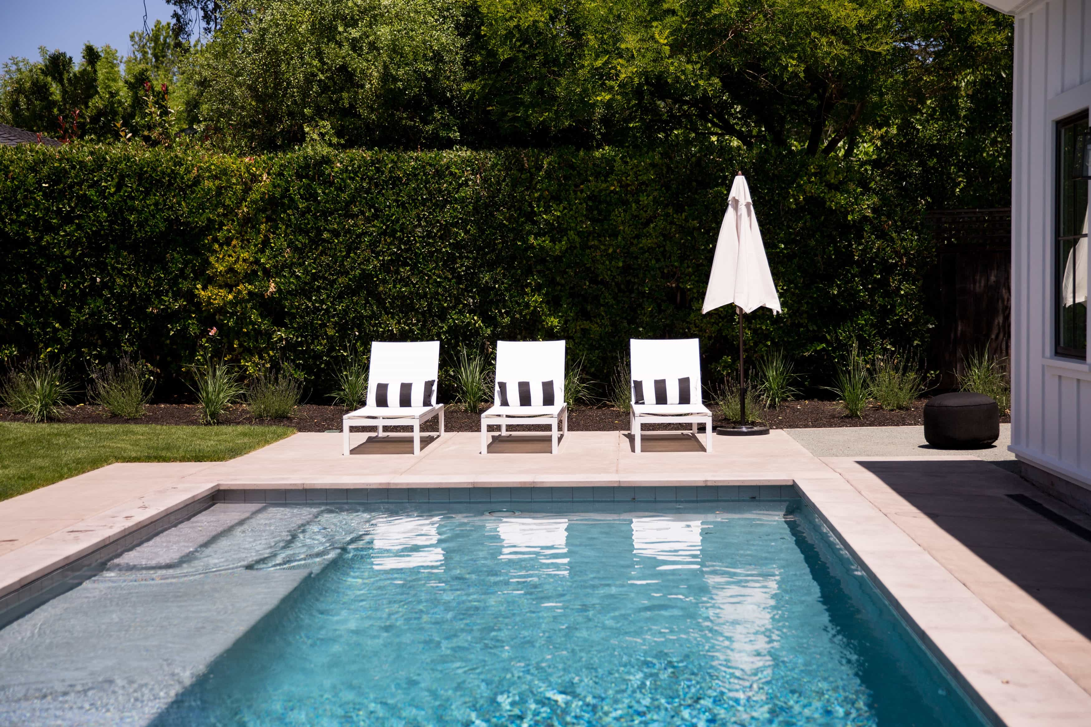 Contemporary Outdoor Pool With Plush Lounge Chairs (View 23 of 25)