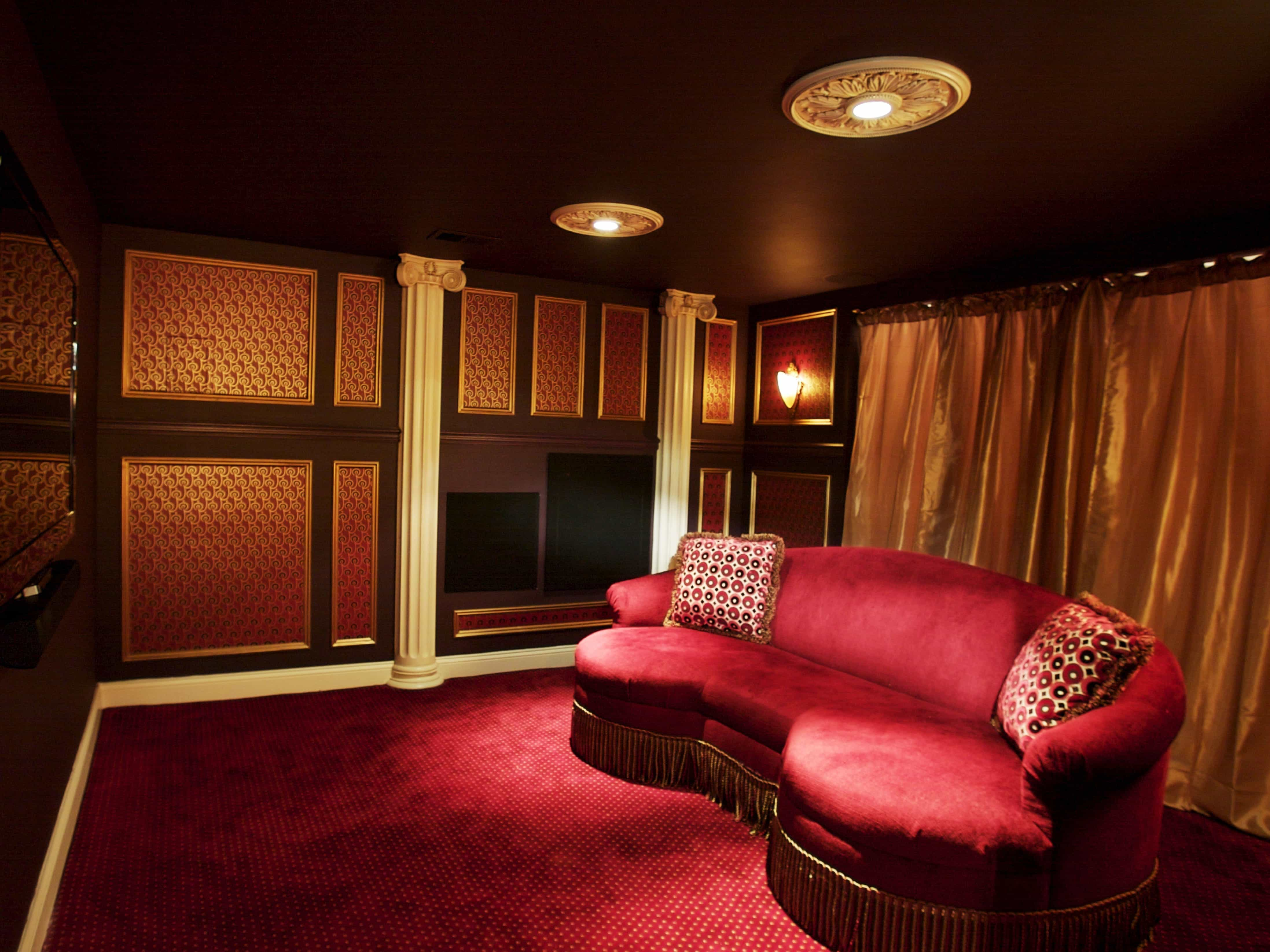 Dramatic Basement Home Theater With Red Sofa (Image 8 of 21)