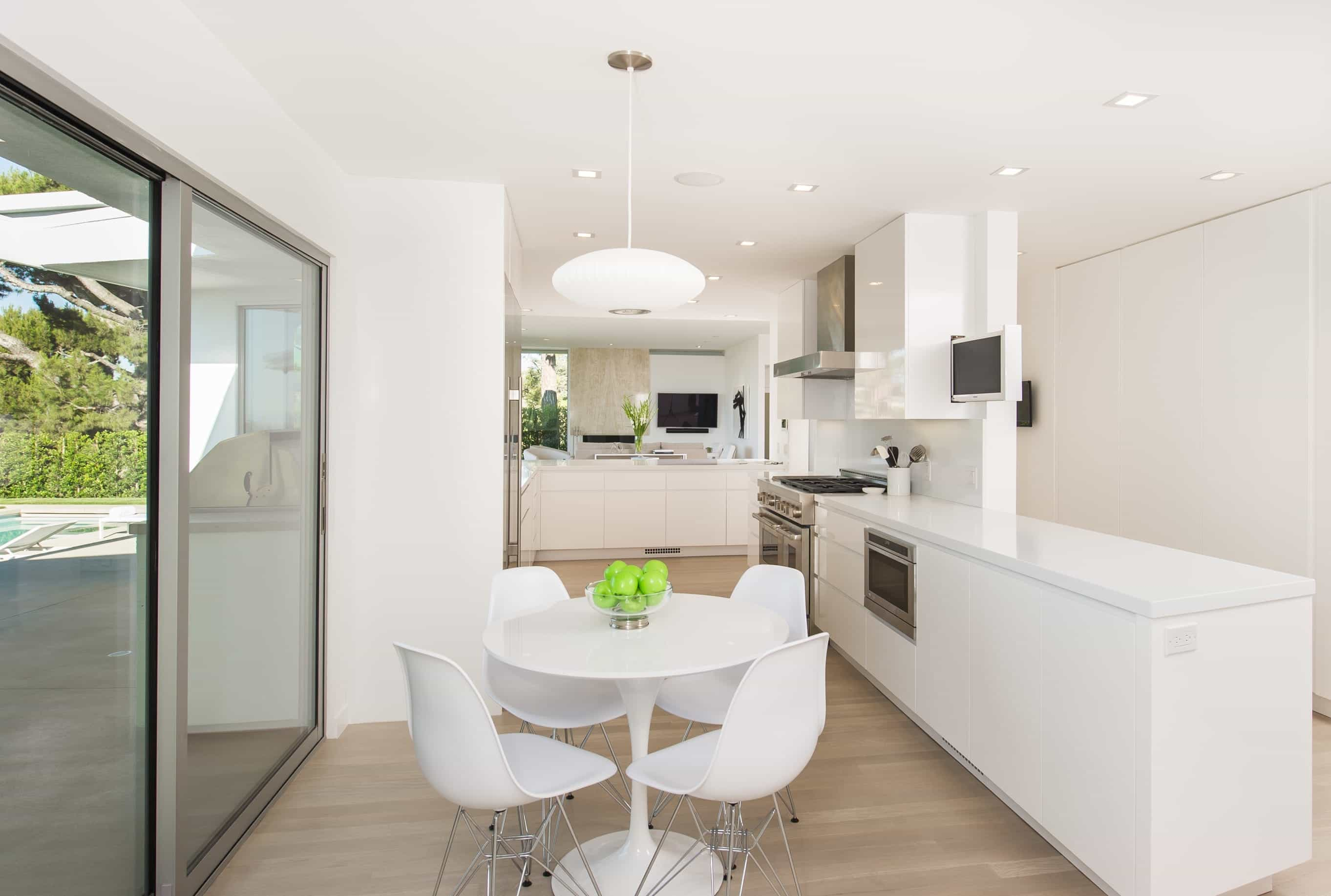 Eat In Apartment Kitchen And Dining Room Combo With Expansive Counter Space And White Round Table (View 12 of 25)