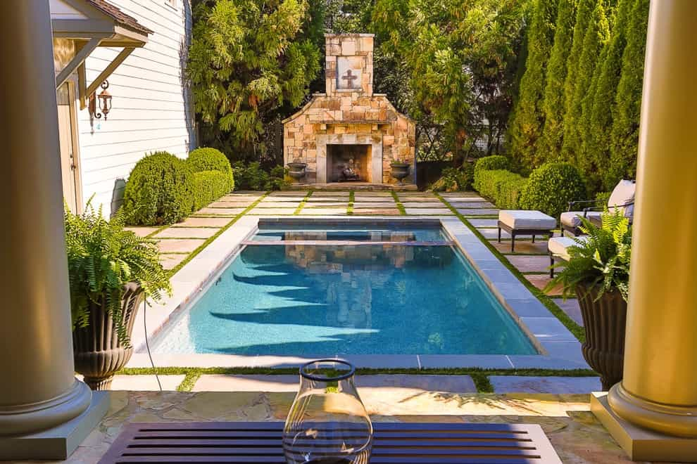 Example Of A Mid Sized Classic Backyard Rectangular Pool Design With A Water Feature (View 12 of 25)