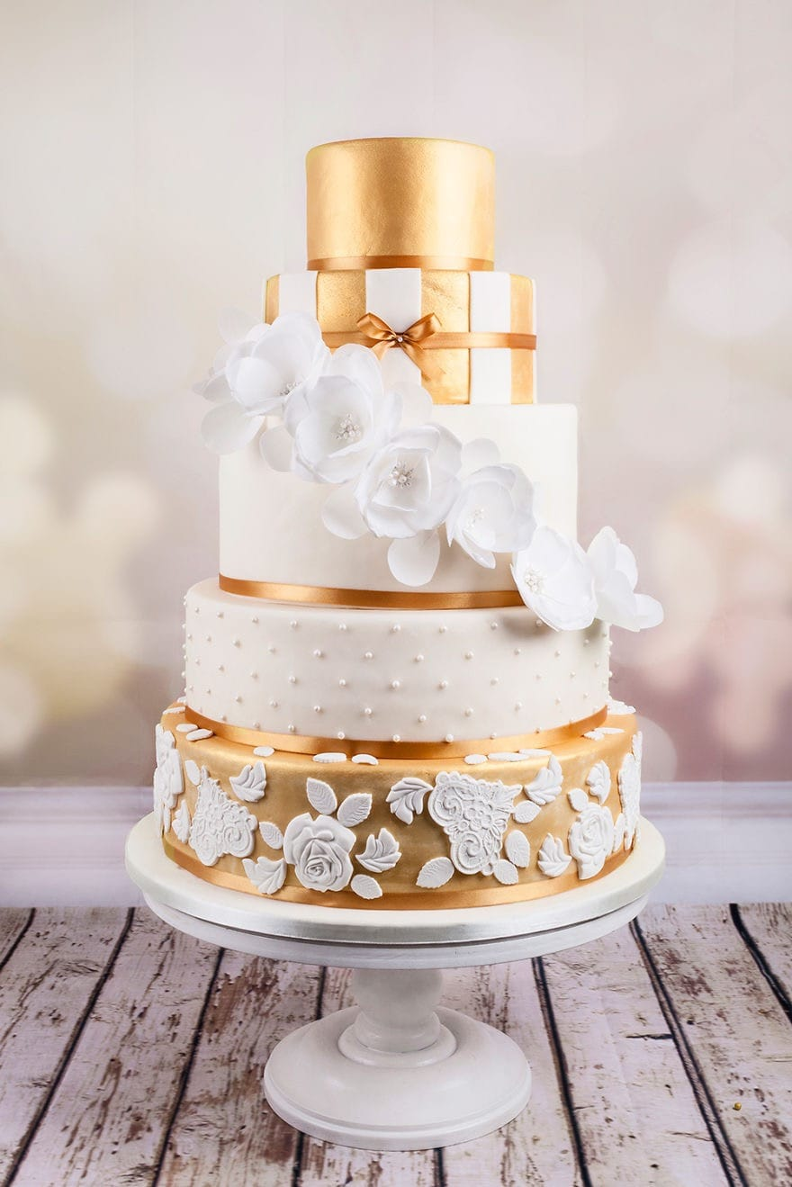 Gold Couture Wedding Cake With White Rose Flower (View 12 of 20)