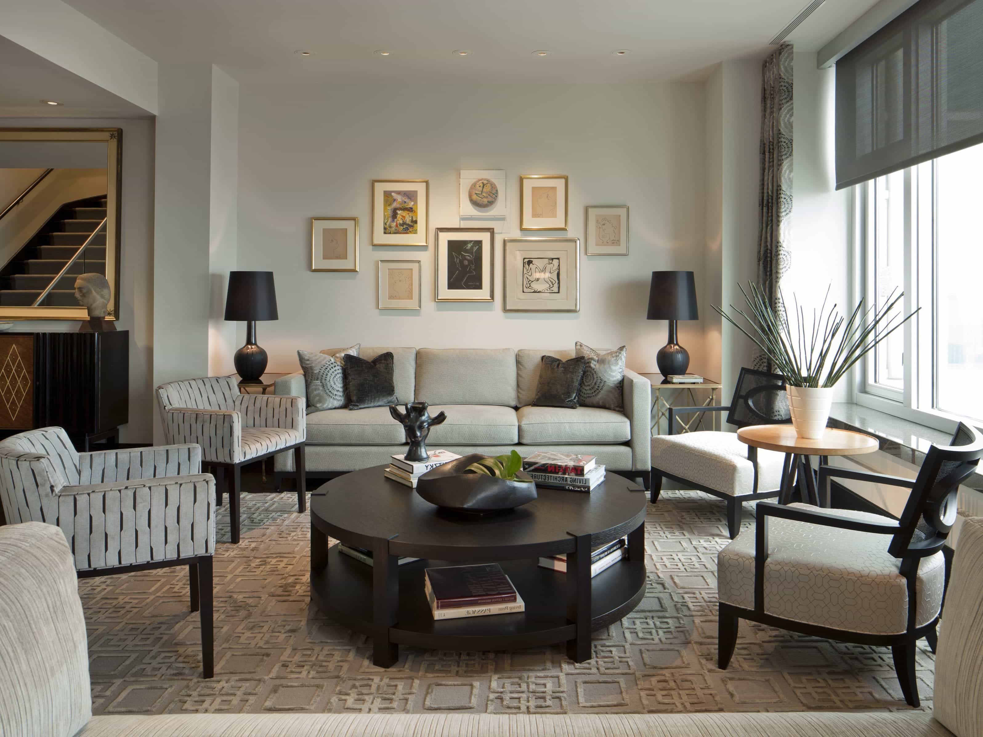 Gray Contemporary Sitting Room With Round Black Coffee Table (Image 16 of 32)