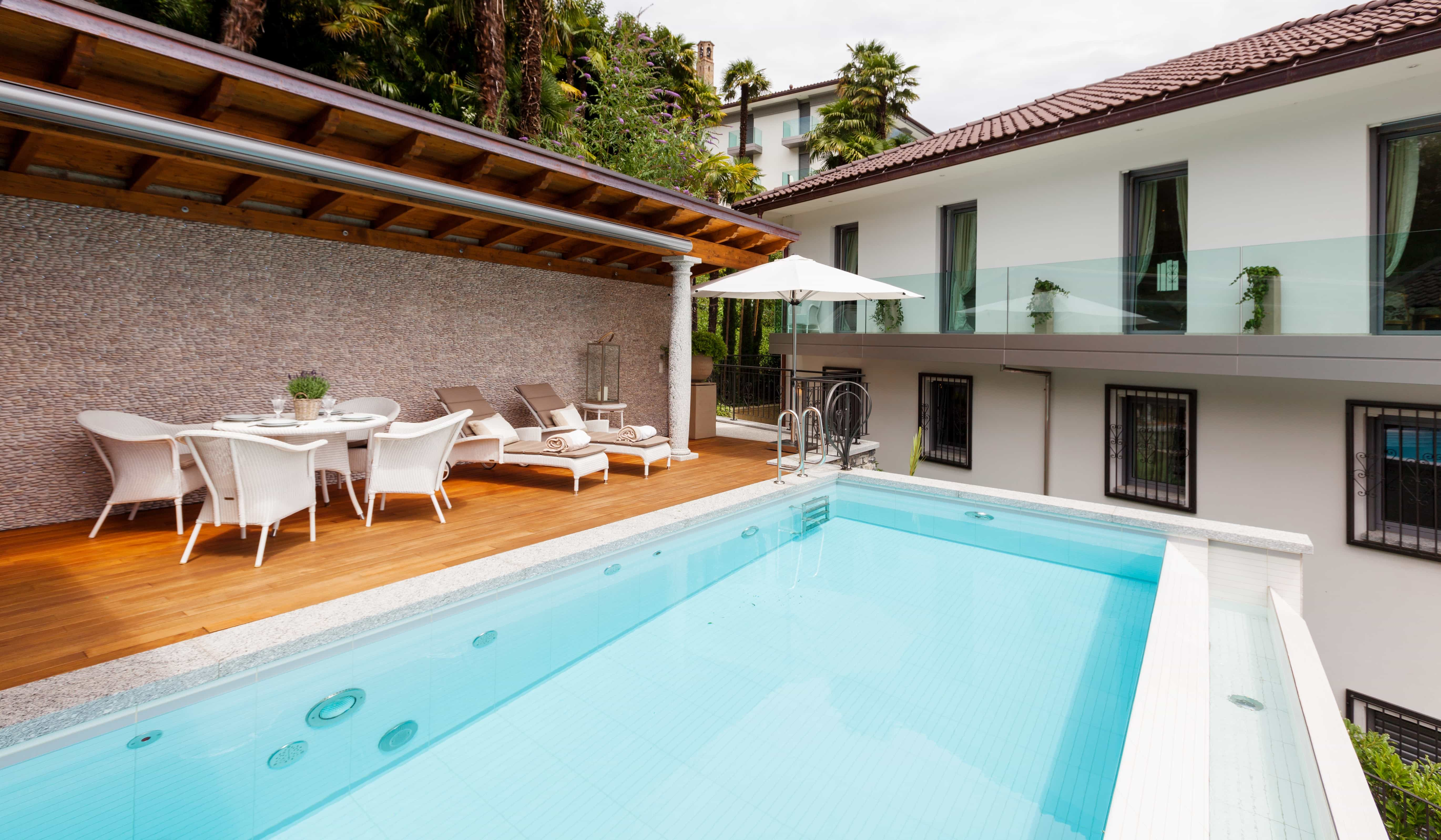 Mediterranean Pool Deck With White Outdoor Furniture (Photo 19 of 25)